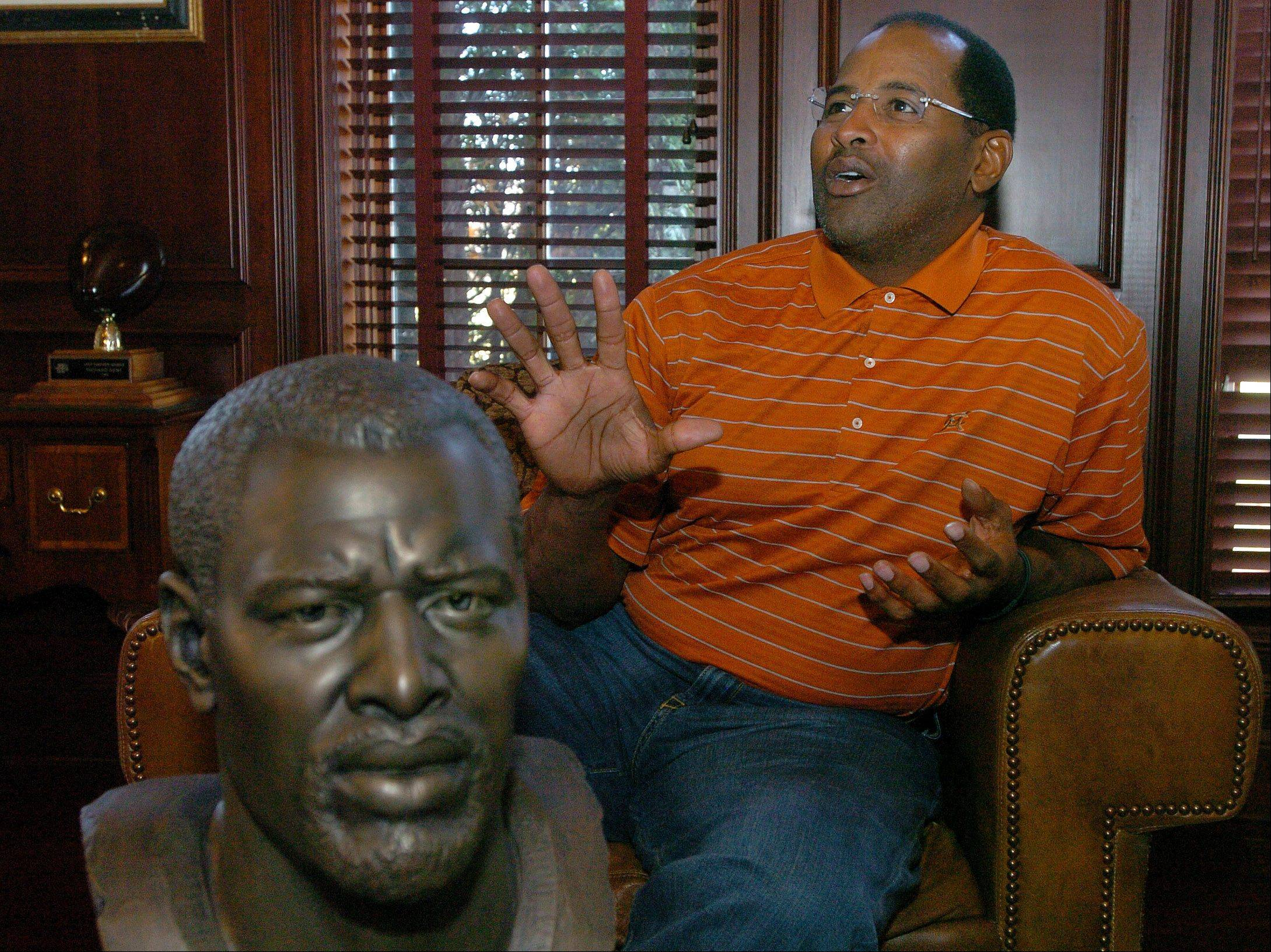 With his Hall of Fame bust in the foreground, Bears legend Richard Dent talks about his violent career from the comfort of his home in Long Grove.
