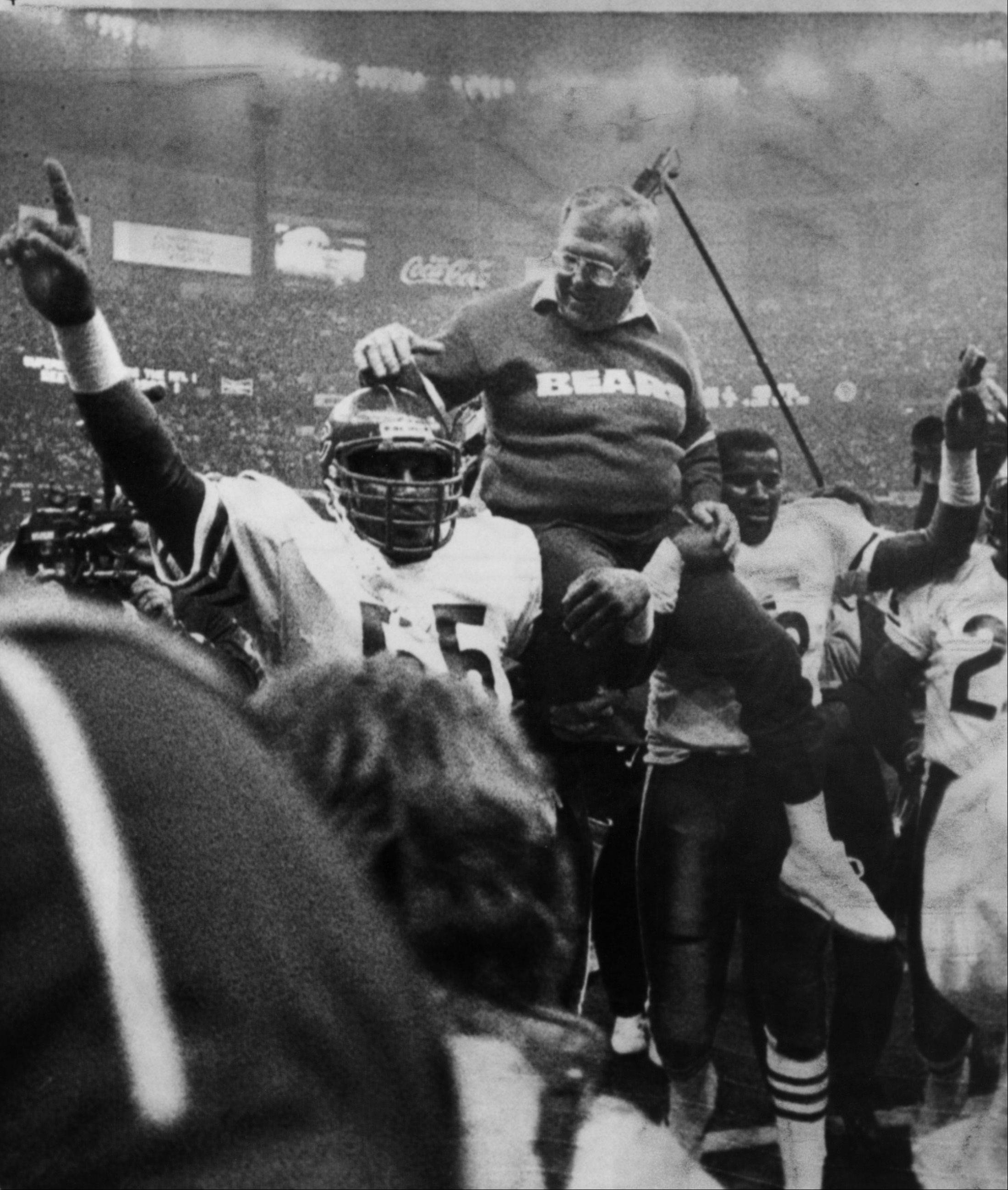 Bears Defensive coordinator Buddy Ryan is hoisted on the shoulders of Otis Wilson, left, and Richard Dent, right, after the 1986 Super Bowl against the New England Patriots at the Superdome in New Orleans.