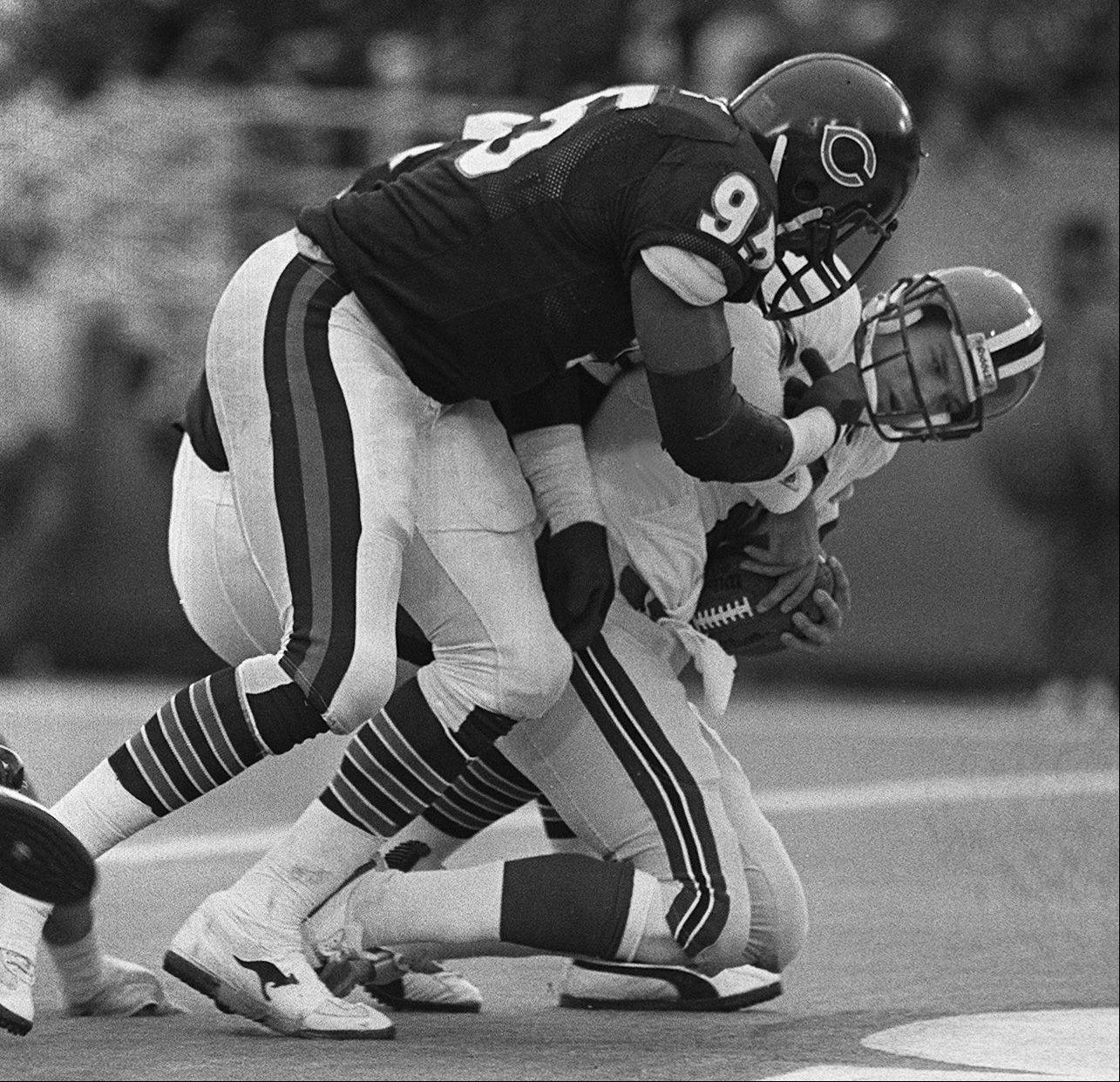 On the way to a Super Bowl championship and MVP award, Richard Dent punished opposing quarterbacks, including this sack against the Atlanta Falcons.