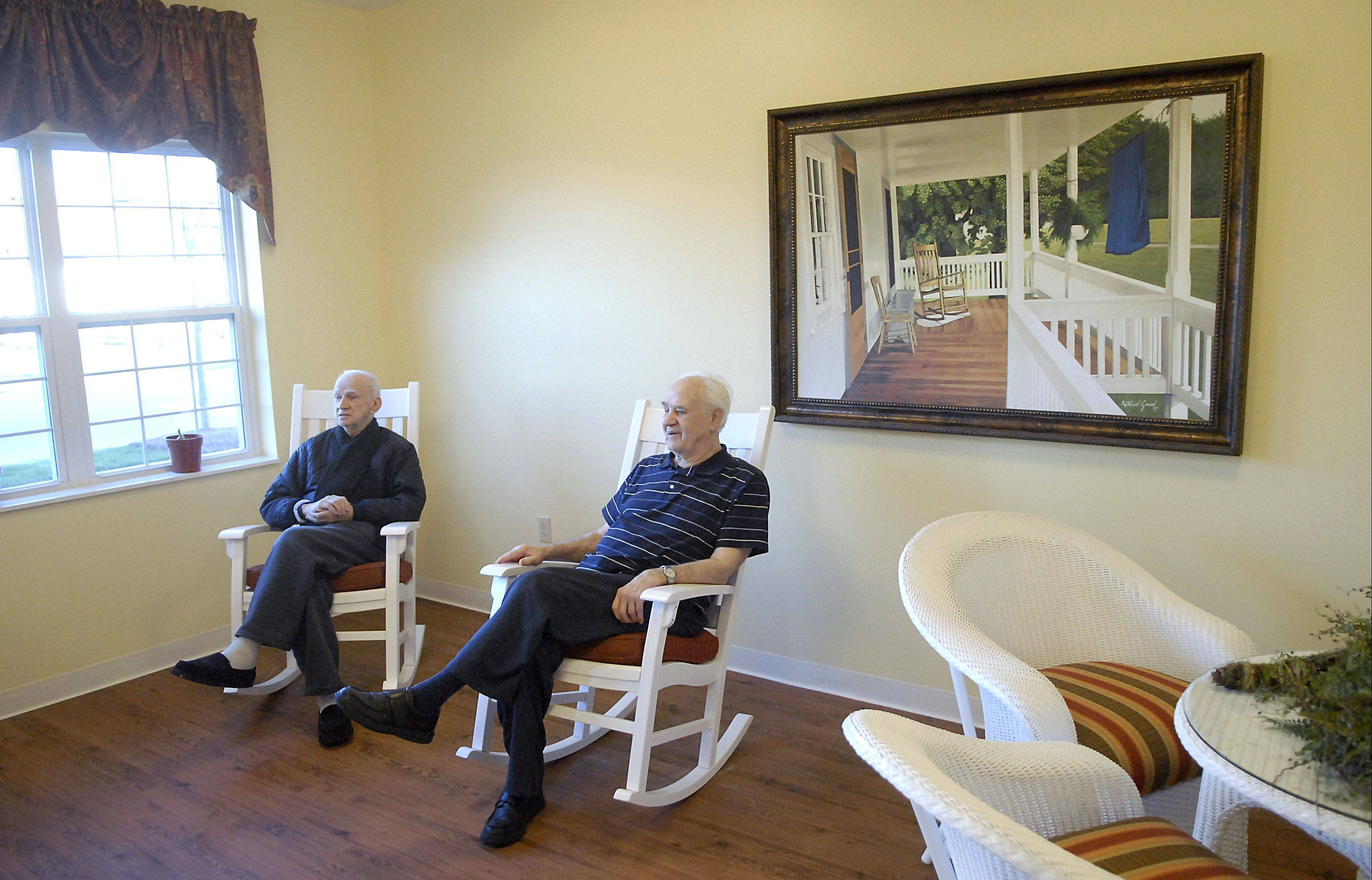 White Oaks residents Claude Demby, left, and Ken Madsen relax in a sitting room at the memory care home in South Elgin. White Oaks at Heritage Woods offers apartment homes for seniors with Alzheimer's disease or related dementia.