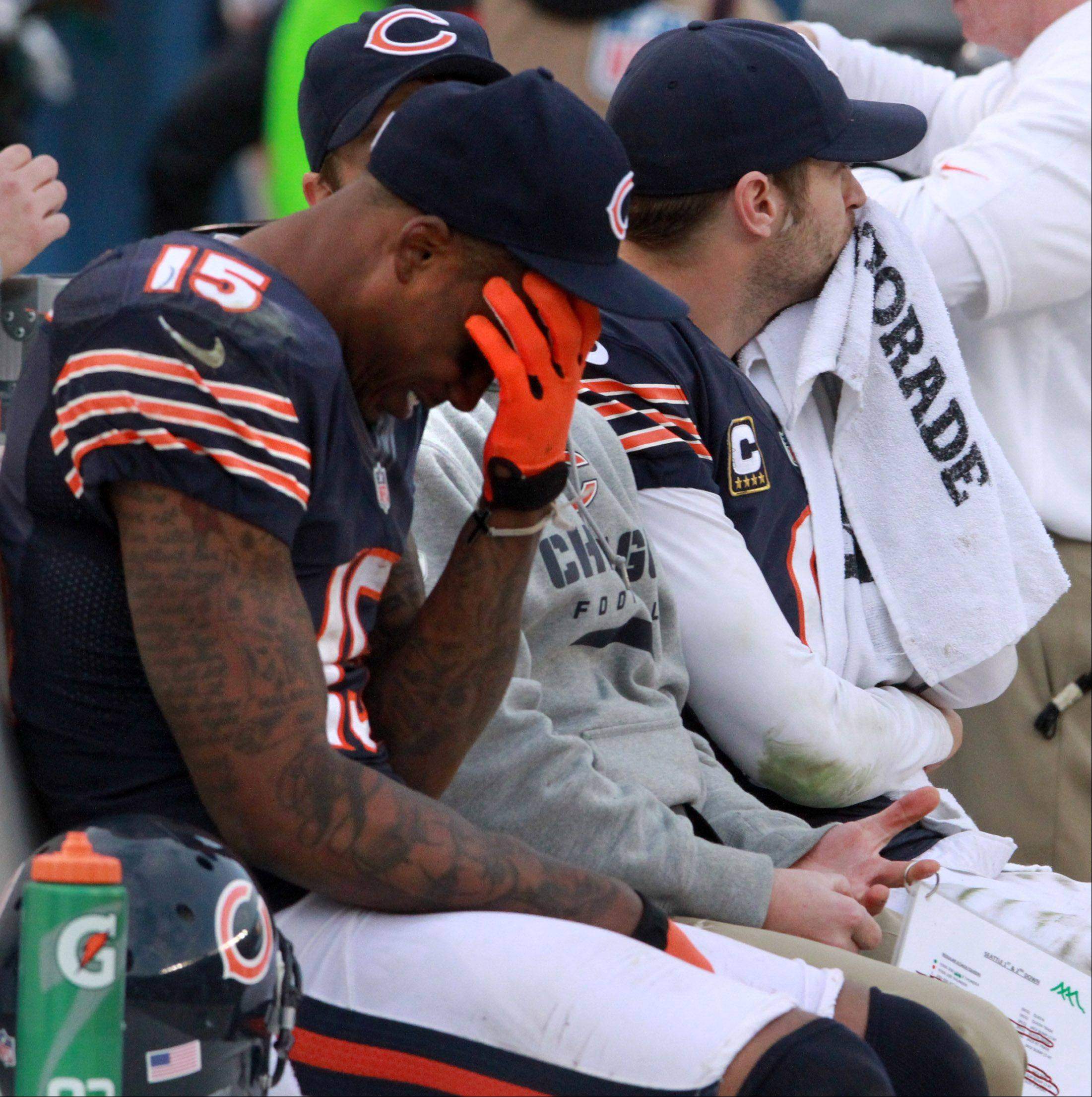 Bears receiver Brandon Marshall and quarterback Jay Cutler react from the bench Sunday as the Seahawks score near the end of regulation at Soldier Field.