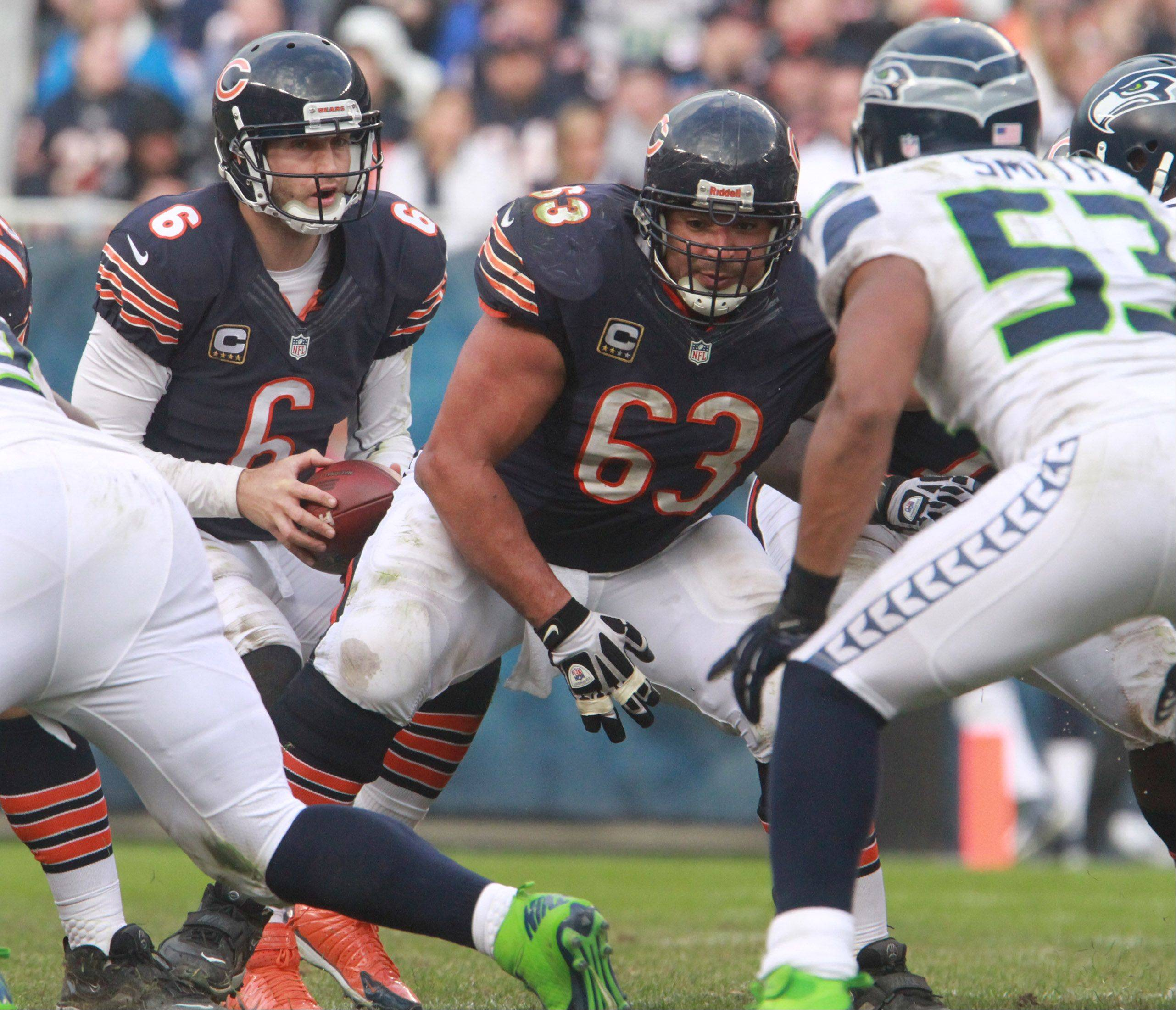 "Roberto Garza blocks after Jay Cutler takes the snap Sunday at Soldier Field. Cutler said he thought the offensive line ""did an OK job."""