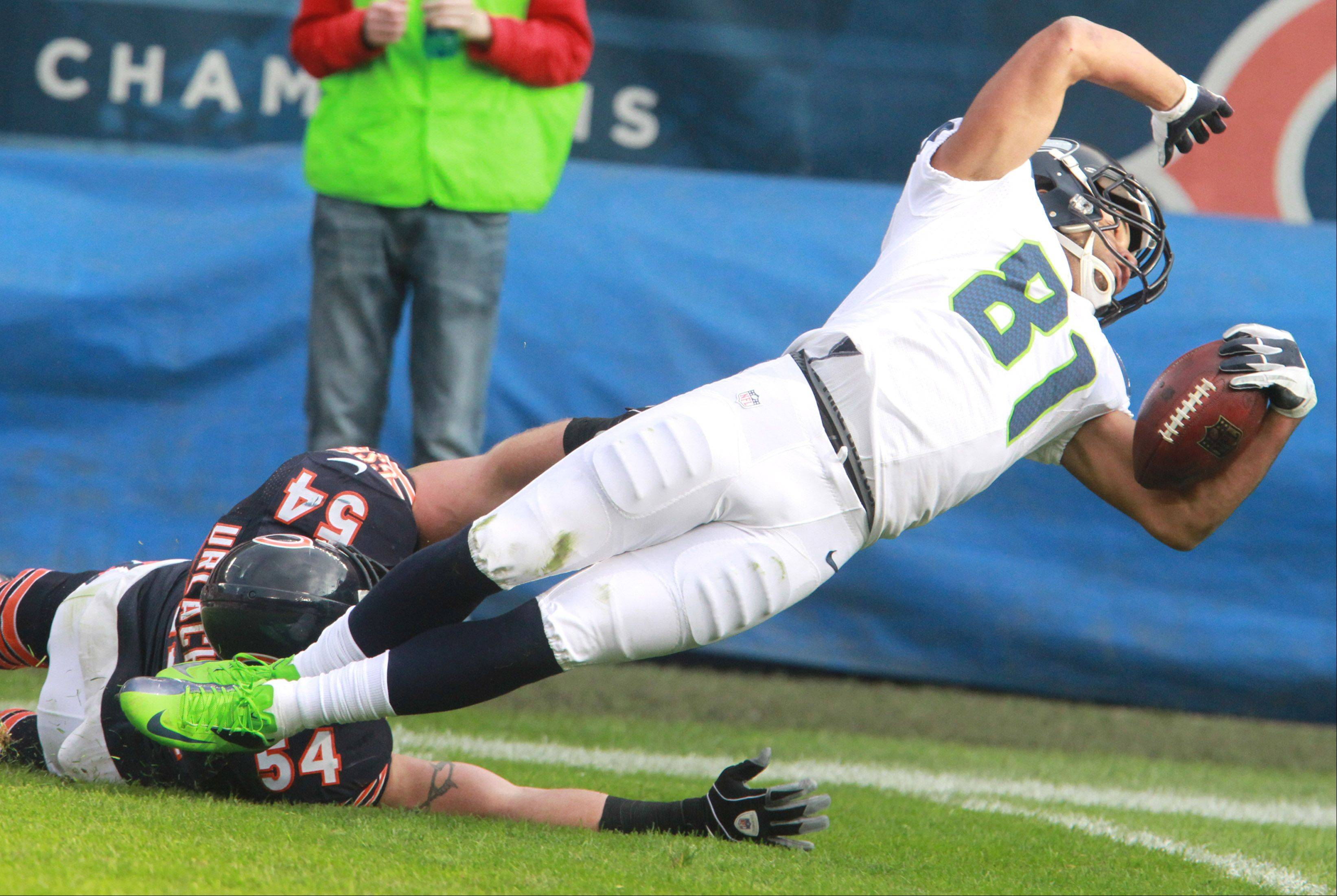 Brian Urlacher stops Seattle Seahawks wide receiver Golden Tate from scoring at Soldier Field on Saturday.