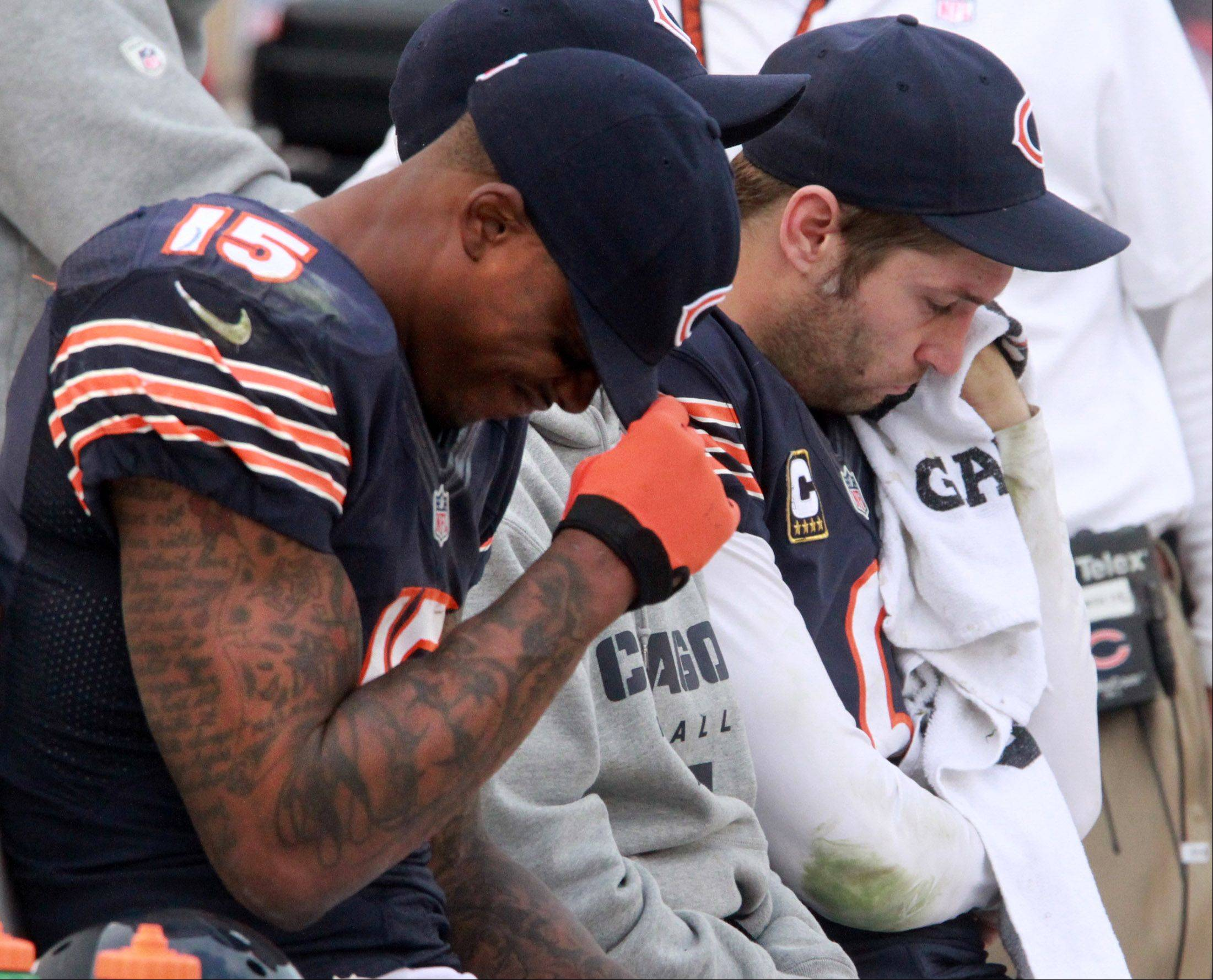 Chicago Bears wide receiver Brandon Marshall and quarterback Jay Cutler sit sullen on the bench as the Seattle Seahawks score a touchdown at Soldier Field on Sunday. The Bears lost in overtime 23-17.
