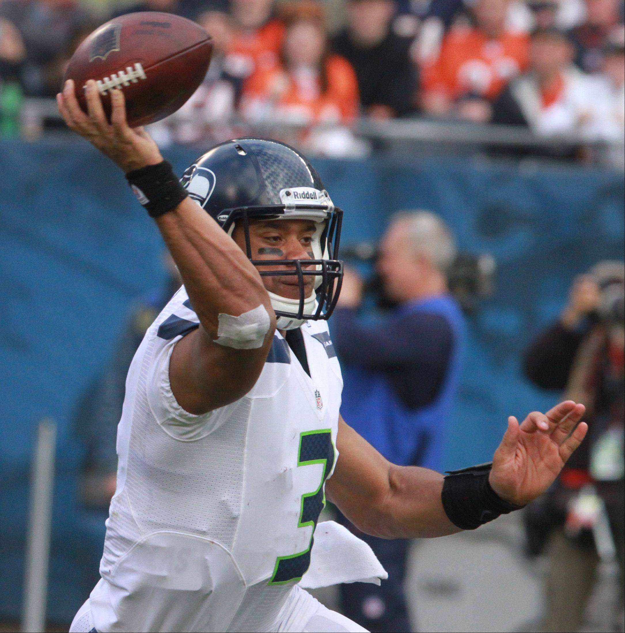 Seattle Seahawks quarterback Russell Wilson passes against the Bears at Soldier Field on Sunday.