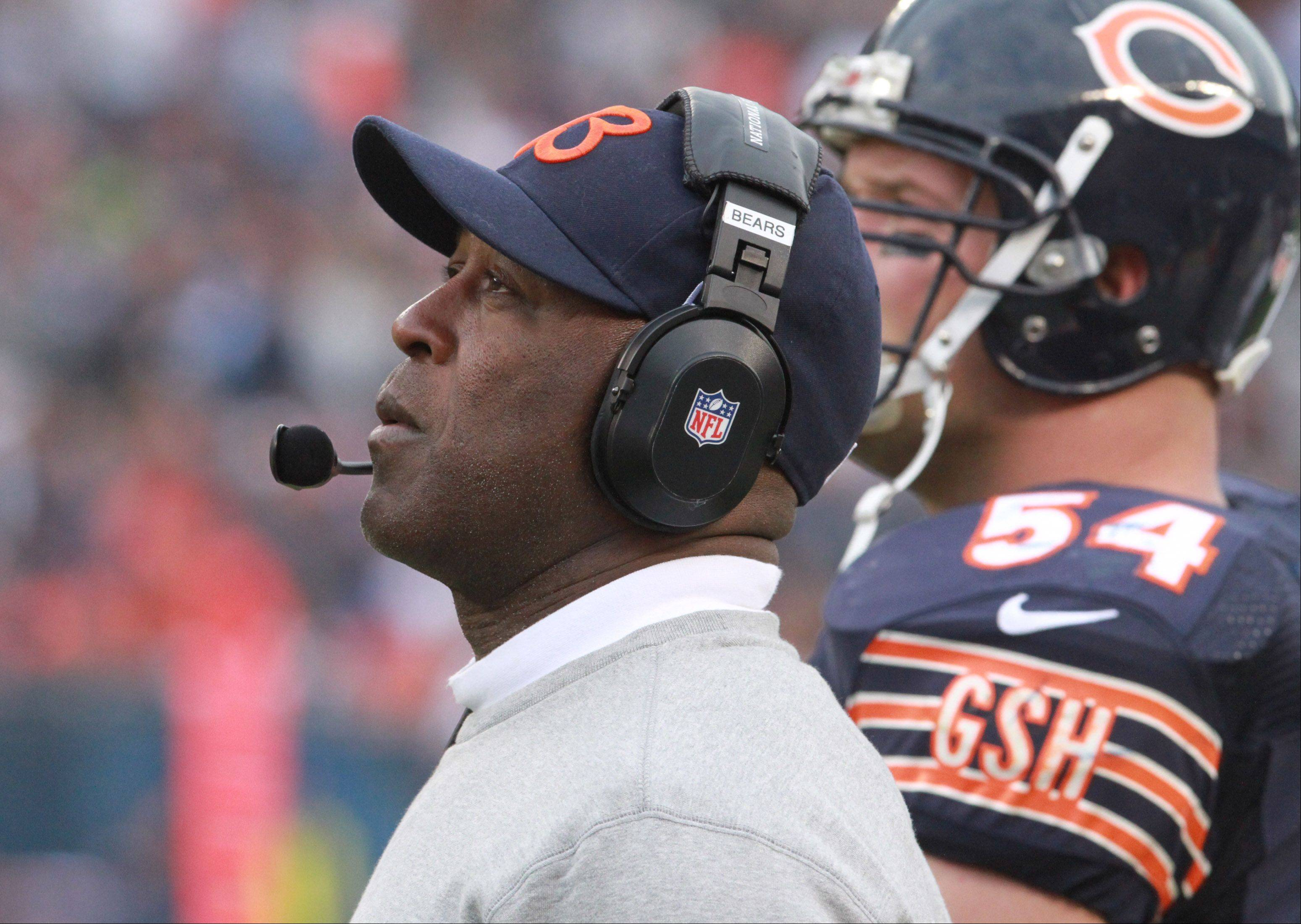 Chicago Bears coach Lovie Smith looks up at the giant replay screen during a replay at Soldier Field on Sunday.