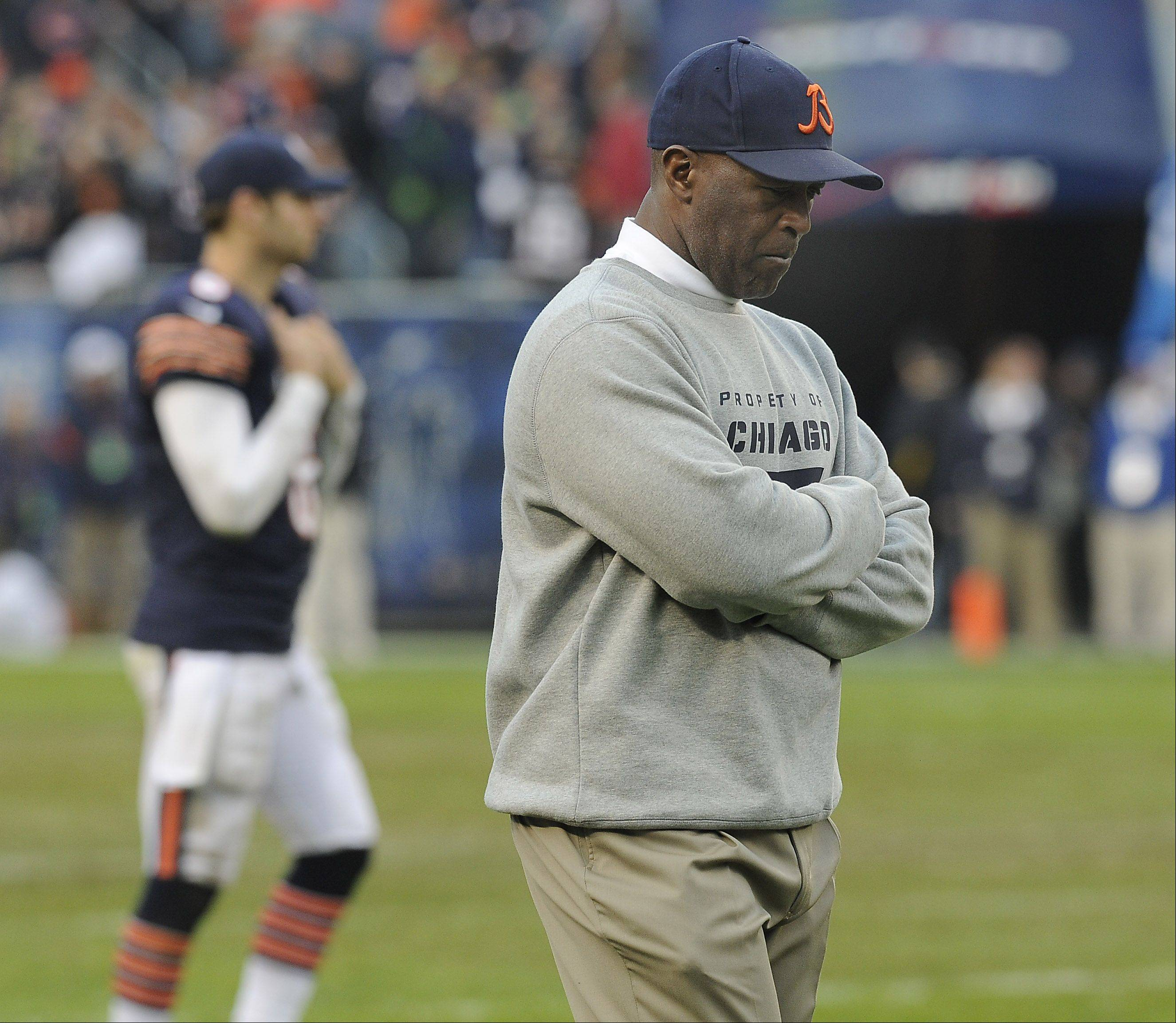 Bears coach Lovie Smith looks down at the end of the game as quarterback Jay Cutler heads off the field in the 23-17 loss the Seahawks at Soldier Field in Chicago.