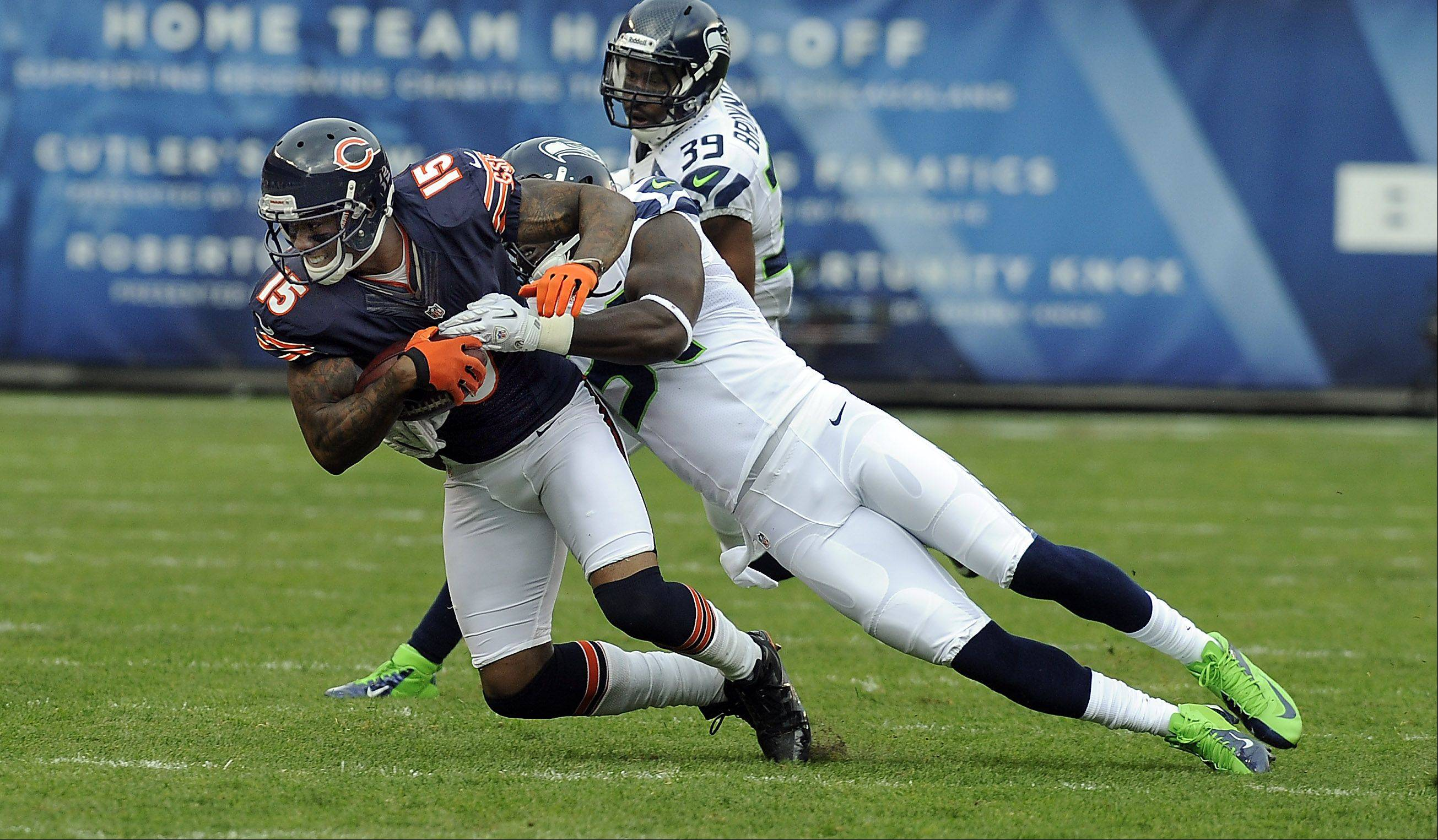 Bears Brandon Marshall on this pass play reception in the first half for yardage as he is tackled by the Seahawks defense at Soldier Field in Chicago.