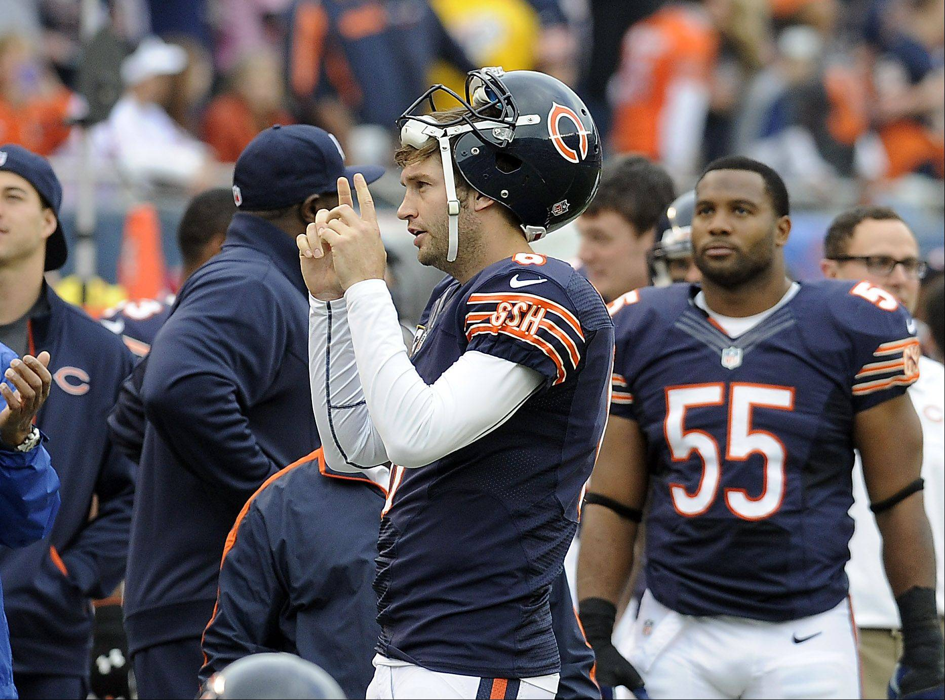 Bears quarterback Jay Cutler signals touchdown after he watched the replay of the touchdown of Earl Bennett in the first quarter at Soldier Field in Chicago.