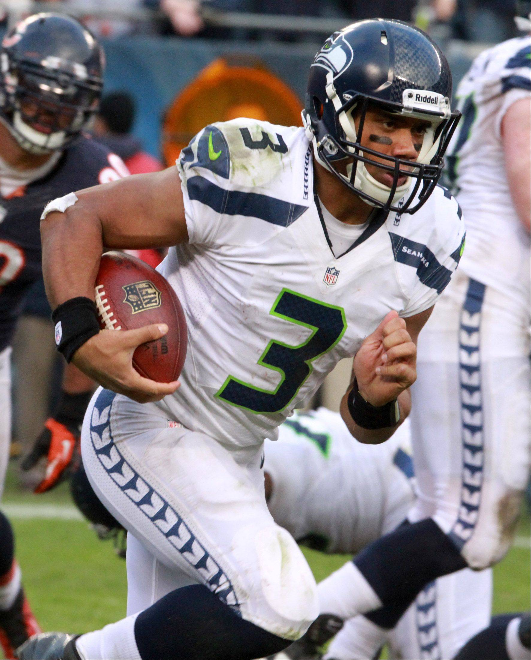 Seattle Seahawks quarterback Russell Wilson runs against the Bears at Soldier Field on Sunday.