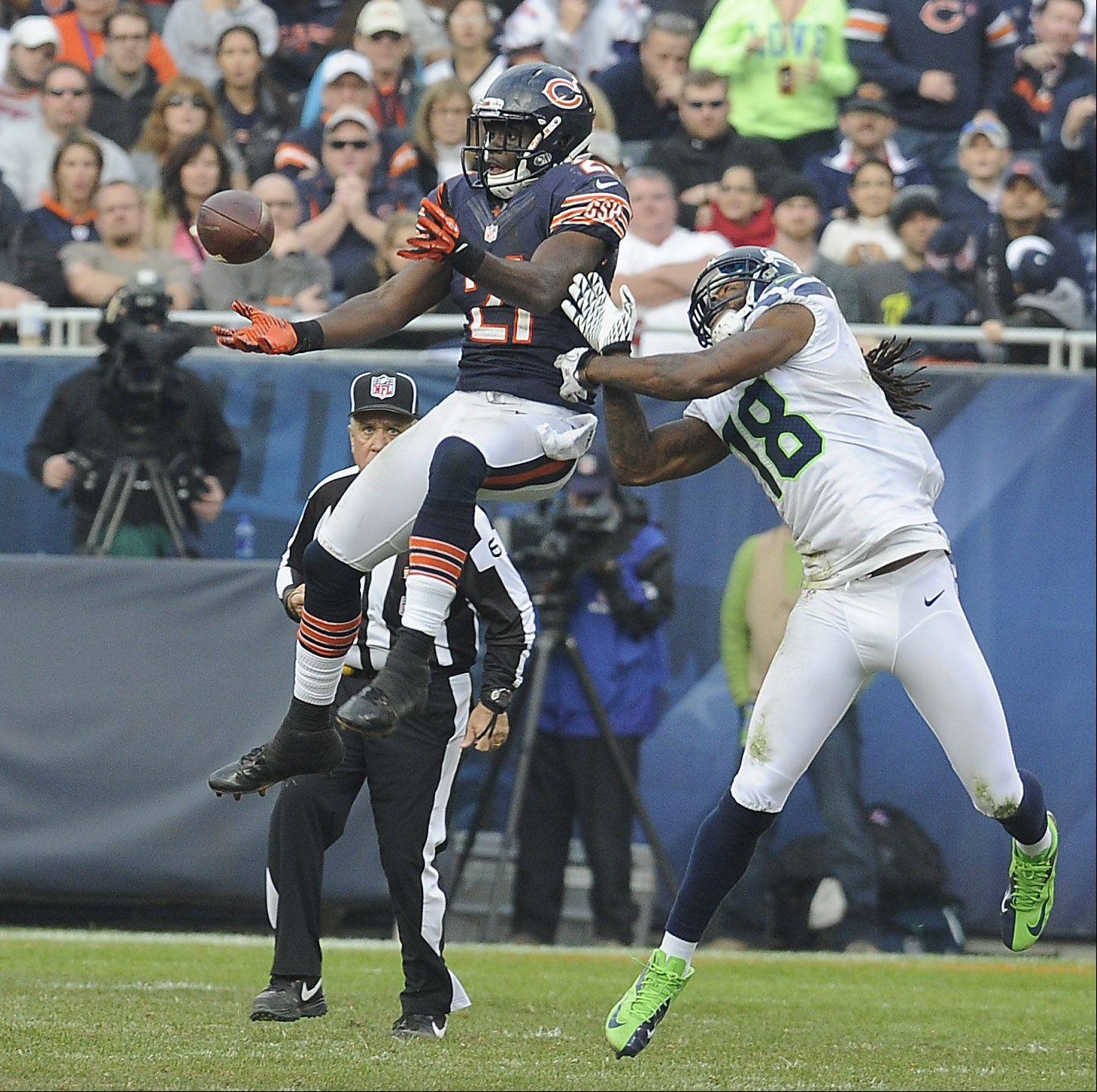 Bears Major Wright breaks up a pass intended for Seahawks Sidney Rice in the 4th quarter as the Bears ended up losing to the Seahawks in overtime at Soldier Field.