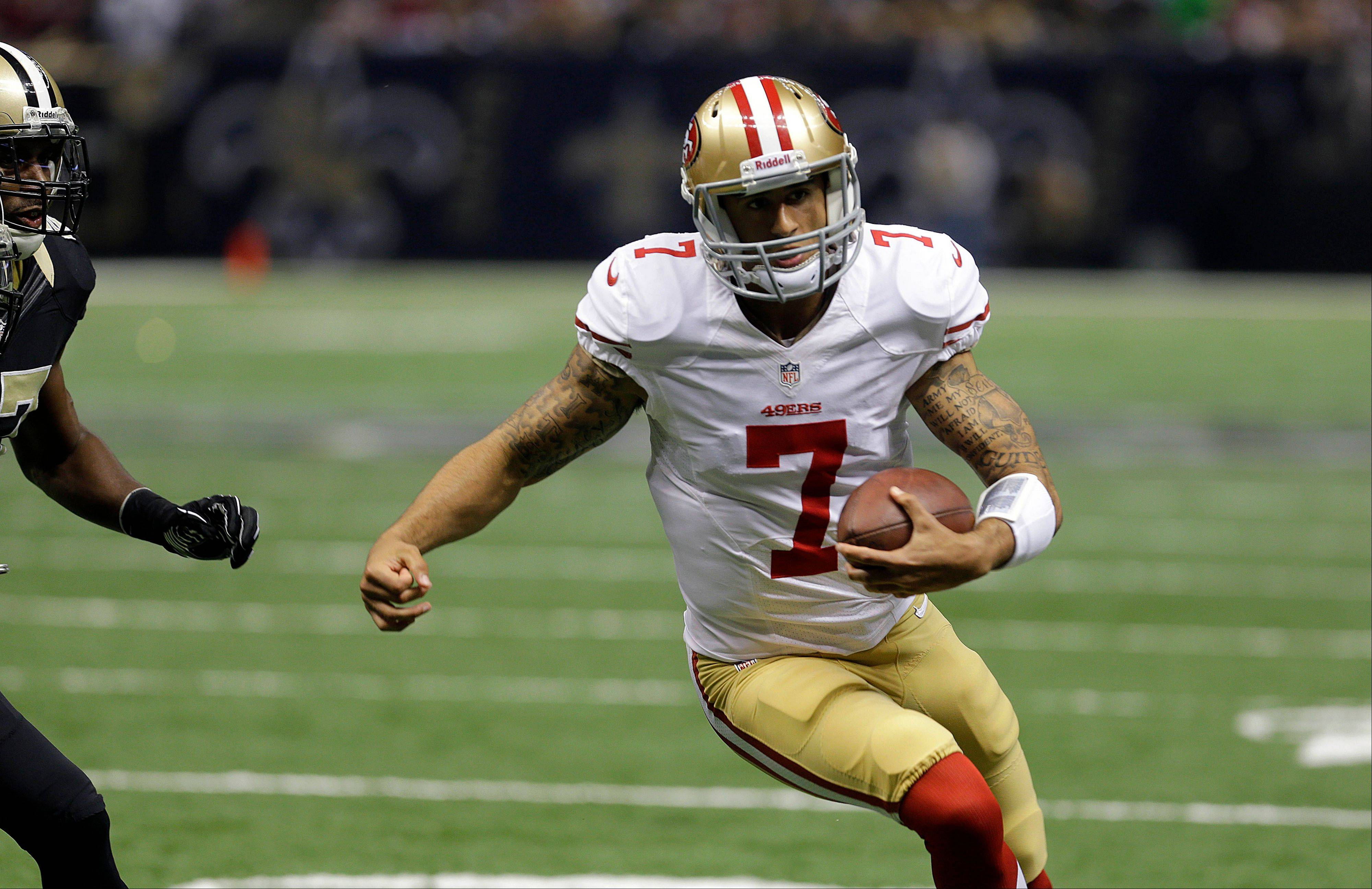 San Francisco 49ers quarterback Colin Kaepernick (7) scrambles for a touchdown against the New Orleans Saints. Kaepernick has starred for the 49ers since starting quarterback Alex Smith went down with a concussion.