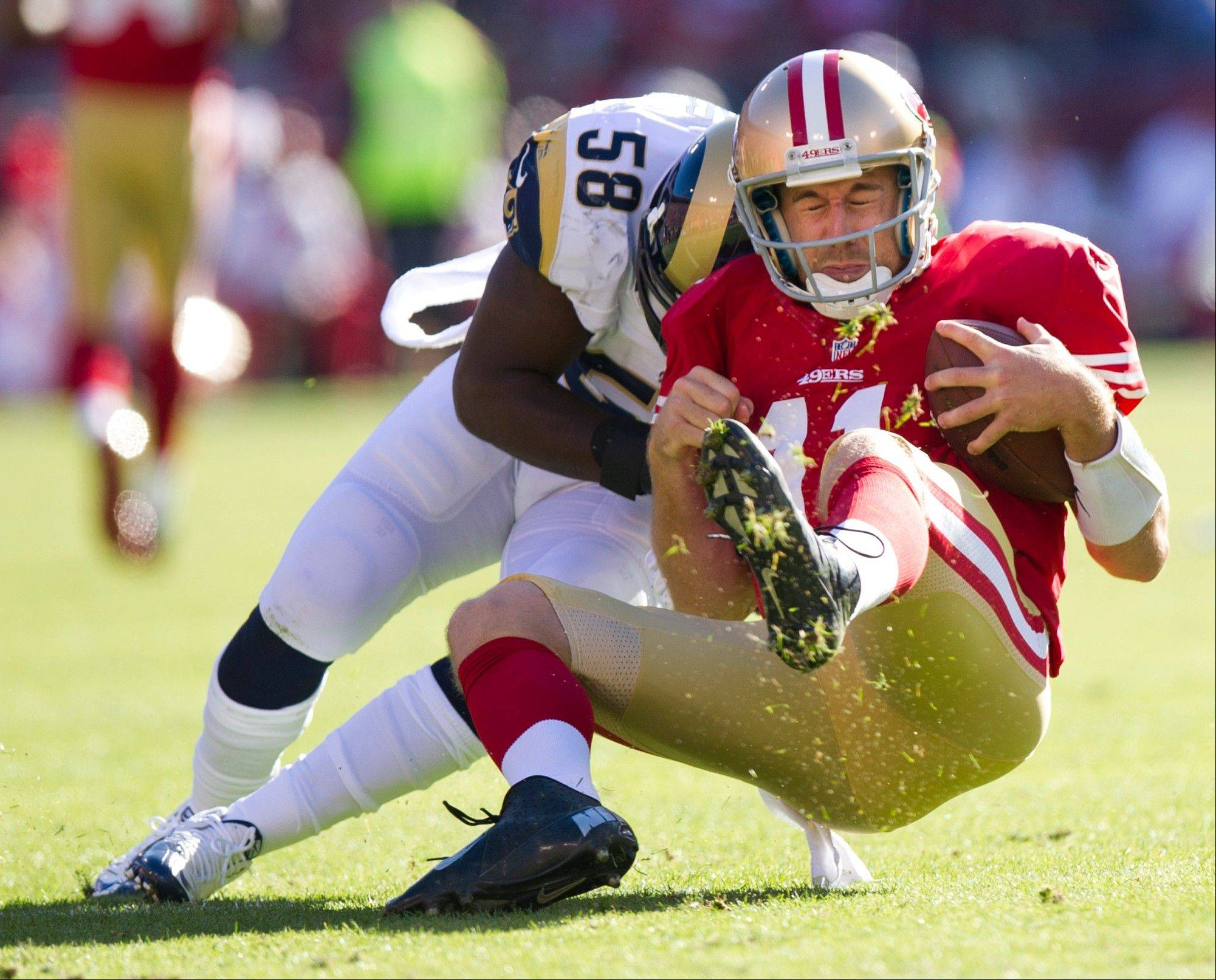 San Francisco 49ers quarterback Alex Smith is tackled by St. Louis linebacker Jo-Lonn Dunbar three weeks ago. Smith had a concussion from the play and has not returned to the field despite doctors clearing him to play.