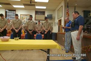 American Legion Sr. Vice Commander Ed Grabowski, right,  and Sons of The American Legion Chaplain Tom Seick, second from right, lead Great Lakes sailors in a prayer before the Thanksgiving meal.