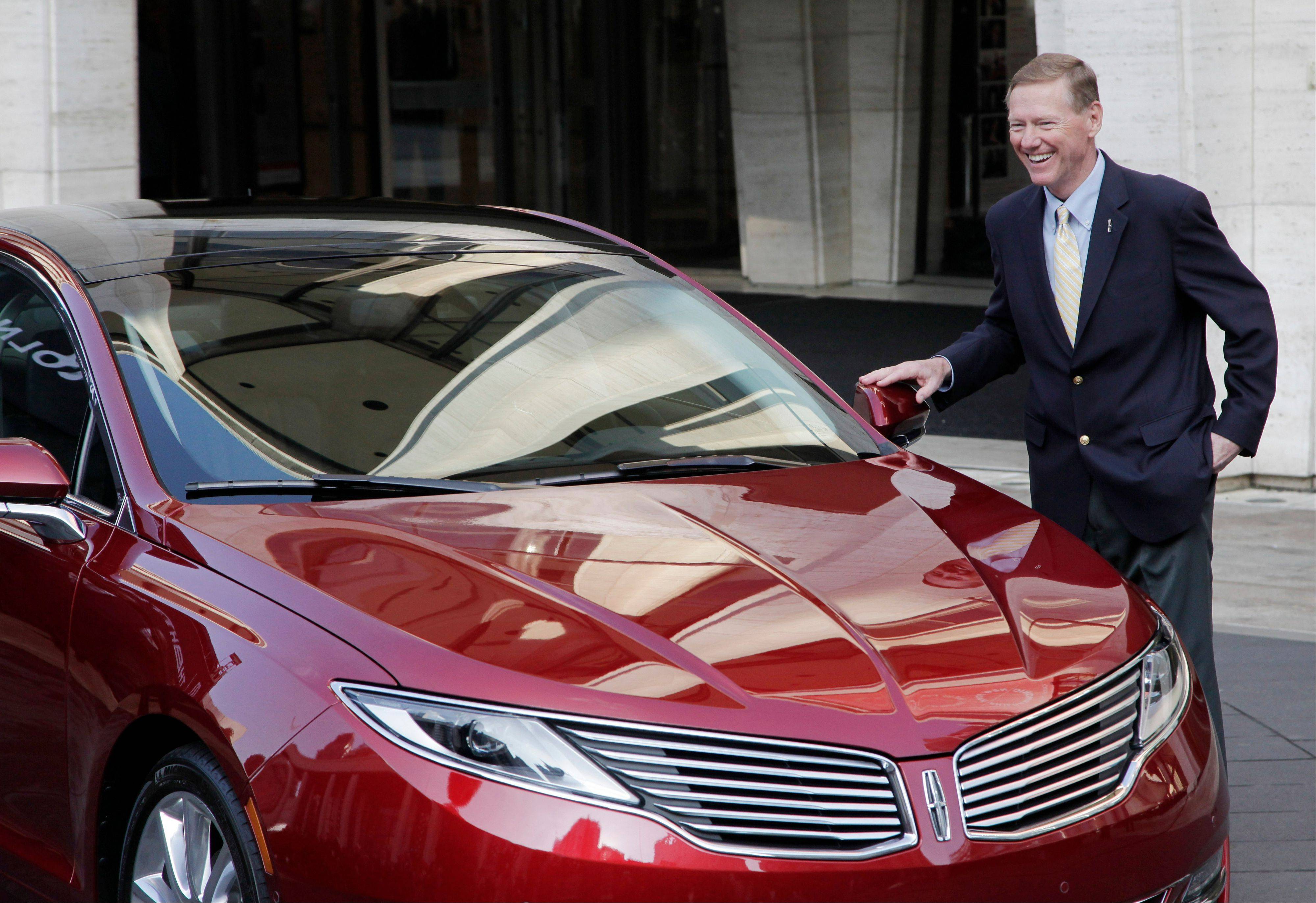 Ford Motor Co. President and CEO Alan Mulally stands beside a Lincoln MKZ during a press conference Monday in New York. The MKZ, the first of seven new or revamped Lincolns that will go on sale by 2015, will arrive at dealerships this month.