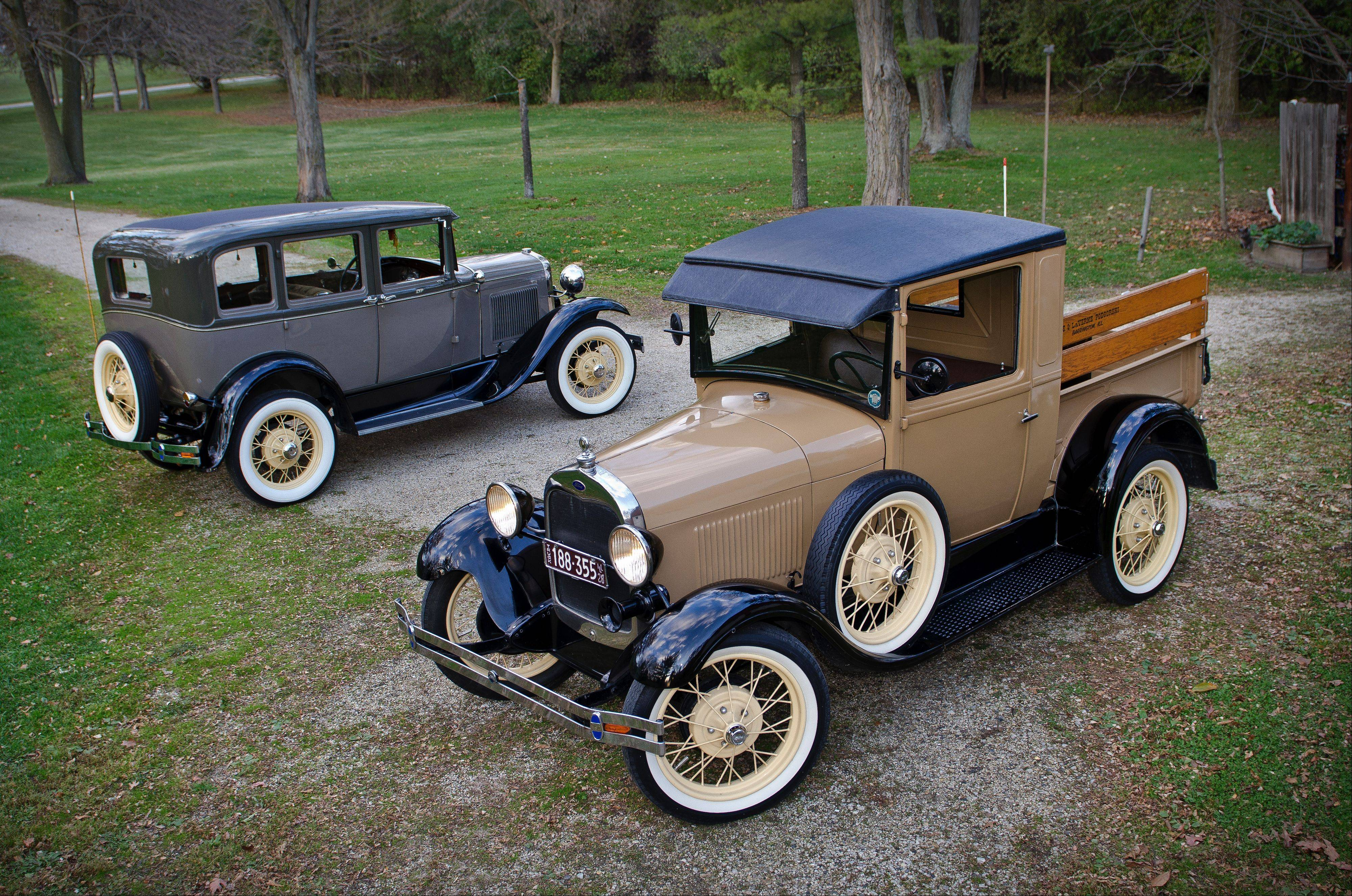 1928 Ford closed cab pickup and 1930 Ford Town Sedan Fodor with Briggs body.