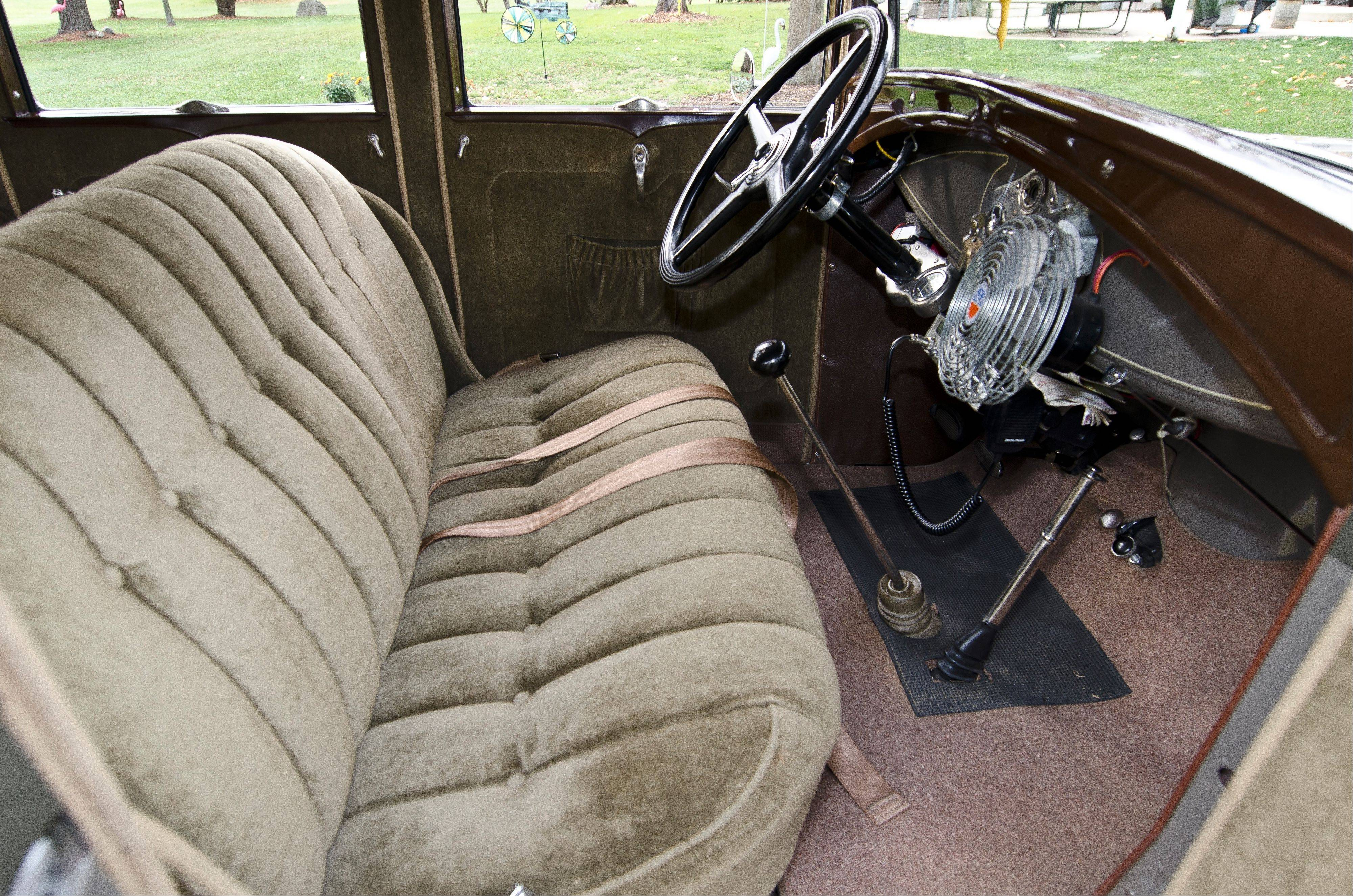 The sedan was given new mohair seats during the rebuild.