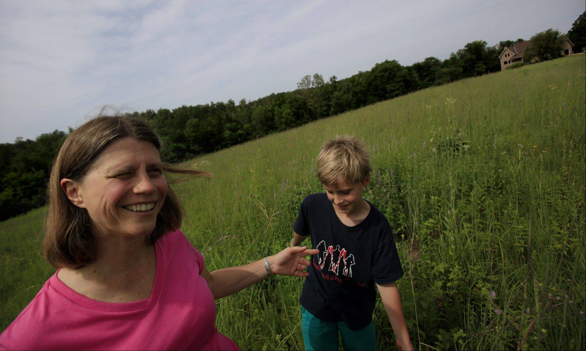Dr. Elizabeth Reeve and her son Luke enjoy relaxing in their prairie garden.