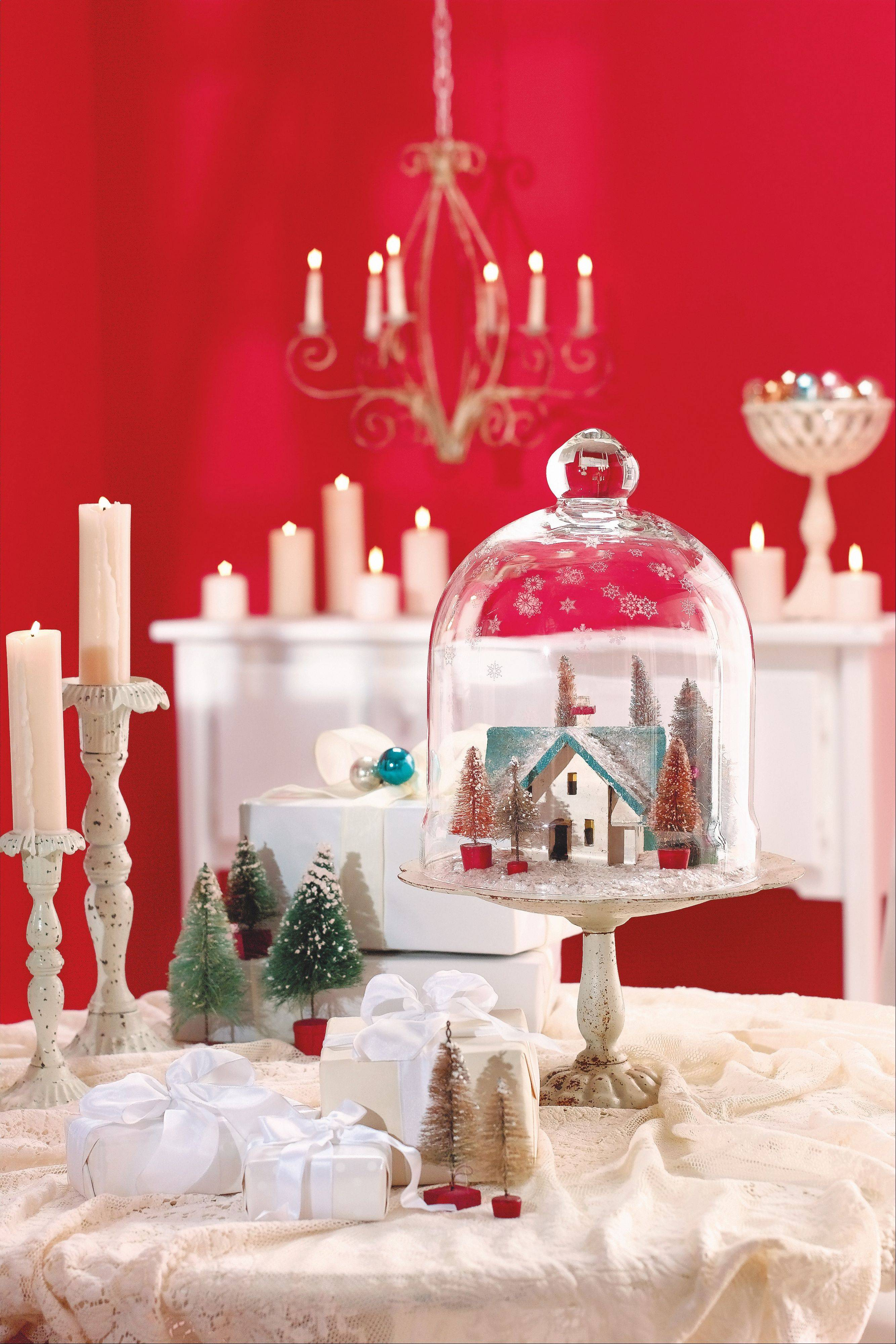 To construct a snow globe illusion that conjures up some holiday magic, use stencils and etching cream to adorn a glass cloche with snowflakes. Arrange a miniature house, bottle-brush trees and a blanket of imitation snow atop a cake plate, and cover the scene with your newly etched cloche. As an alternative to building a village, pile pinecones, greenery, berries or clove-studded oranges on the plate before adding the cloche.