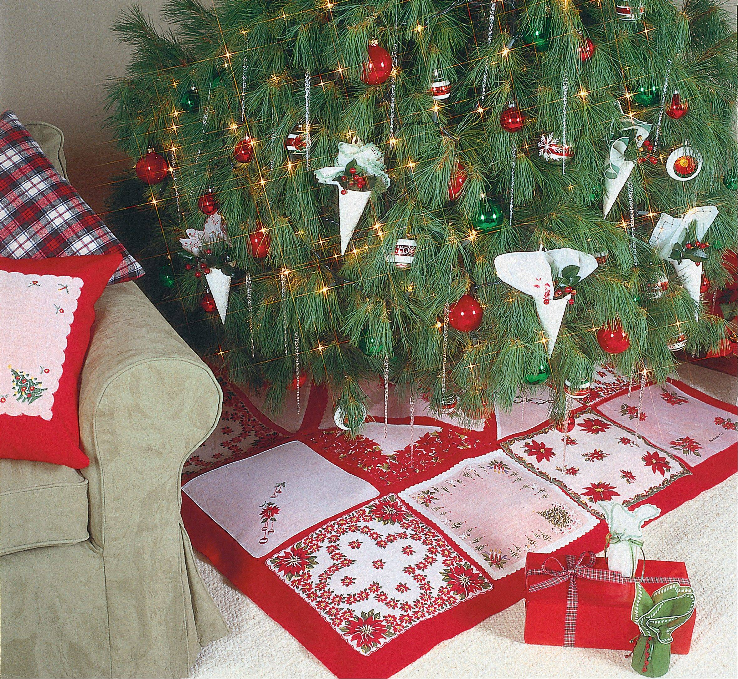 2. Holiday hankies: Shop thrift stores and antiques shops to find handkerchiefs sporting yuletide hues or motifs. Use the colorful squares to embellish everything from tree skirts and table runners to pillows and packages. To create a one-of-a-kind tree skirt, cut a square of red felt to your desired size. Arrange the handkerchiefs (or squares cut from holiday-patterned fabrics) on top of the square in a pleasing design. Fuse the hankies to the felt with spray adhesive or paper-backed adhesive web, such as HeatnBond. (For extra staying power, stitch around the handkerchief edges with a sewing machine.) Cut a slit from the back edge of the felt to the center of the square; cut out a 5-inch circle from the skirt's center to accommodate the tree trunk.