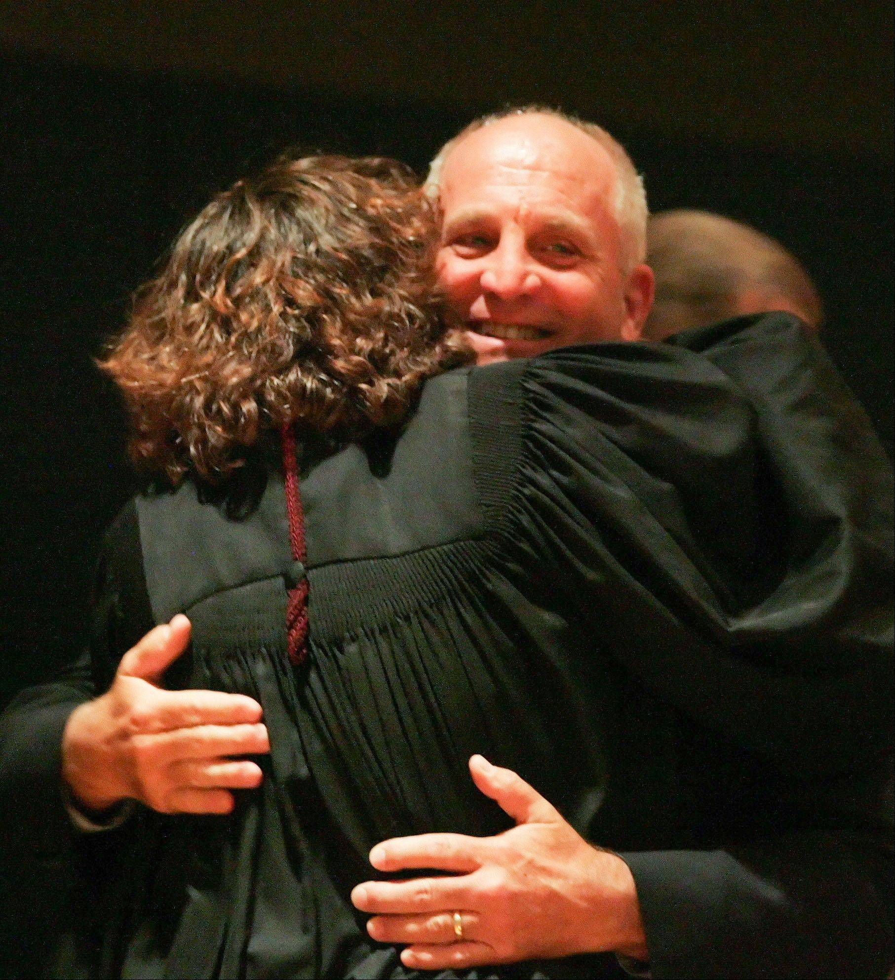 Richard Jorgensen hugs his wife, appellate judge Ann Jorgensen, after she swore him in as coroner at the 2012 Inauguration of DuPage County elected officials at the Jack T. Knuepfer Administration building in Wheaton on Monday.