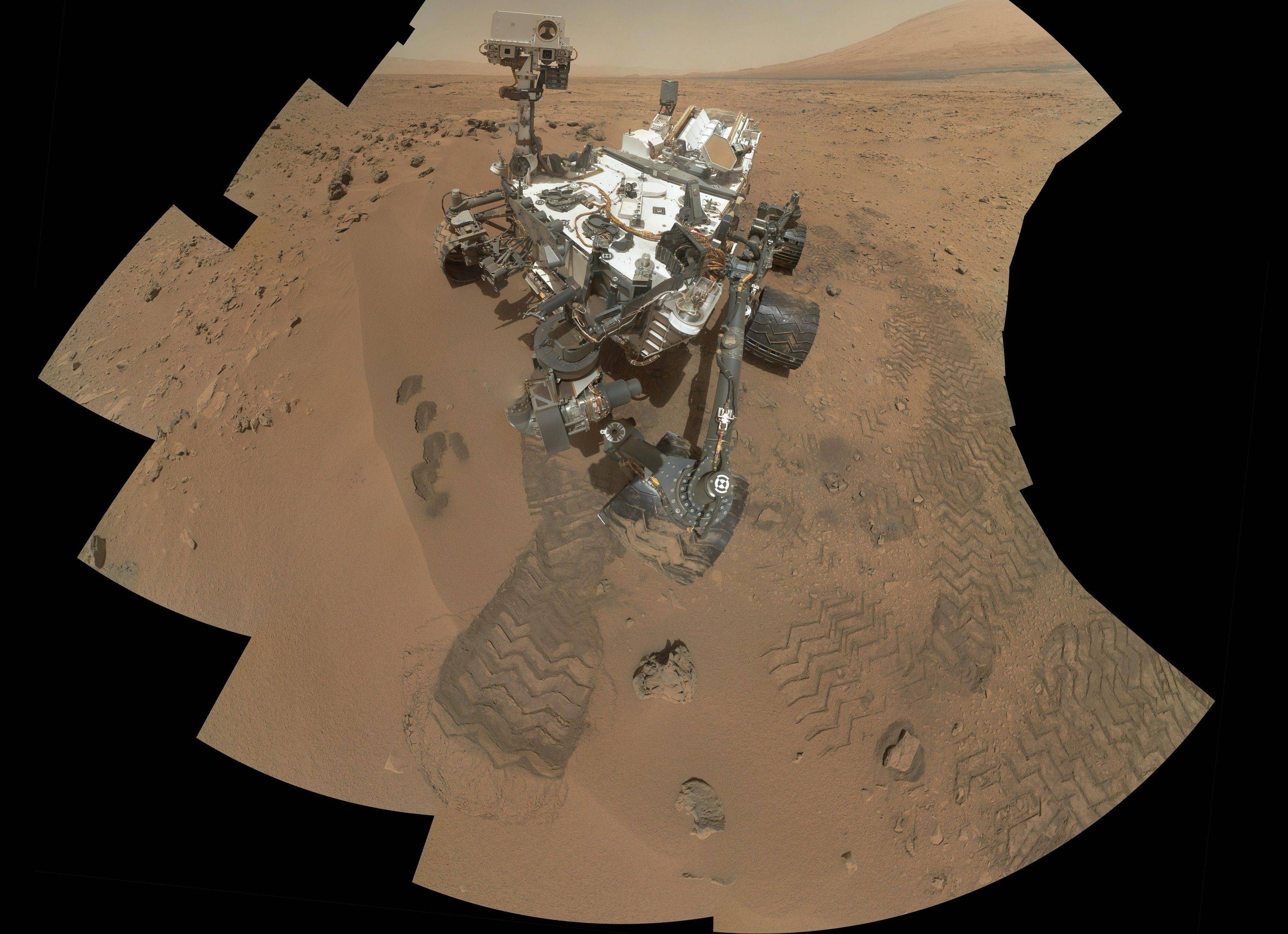 This image released by NASA shows the work site of the NASA's rover Curiosity on Mars. Results are in from the first test of Martian soil.
