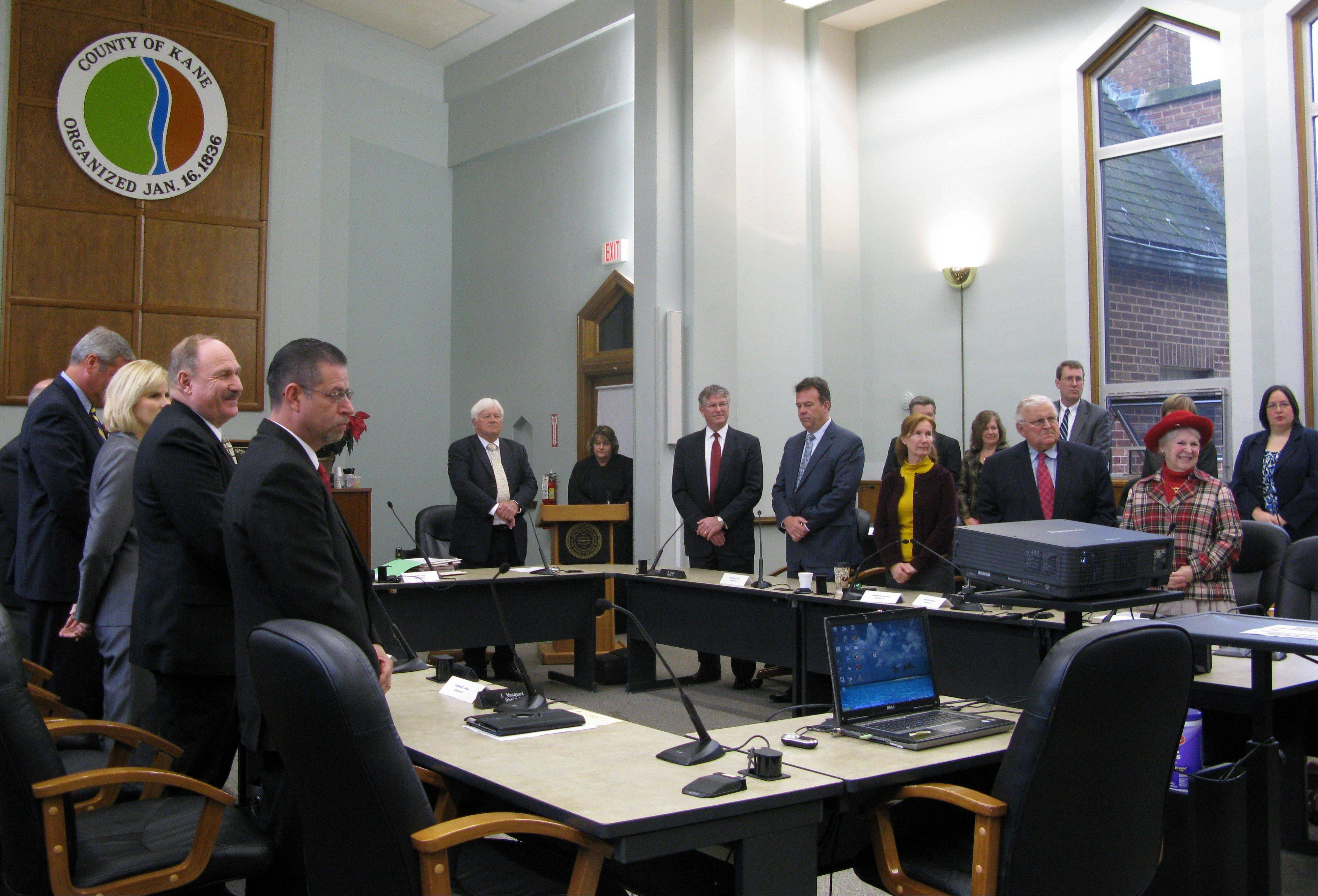 The new, 24-seat Kane County Board took its oath of office Monday morning with pep talk from Chairman Chris Lauzen.