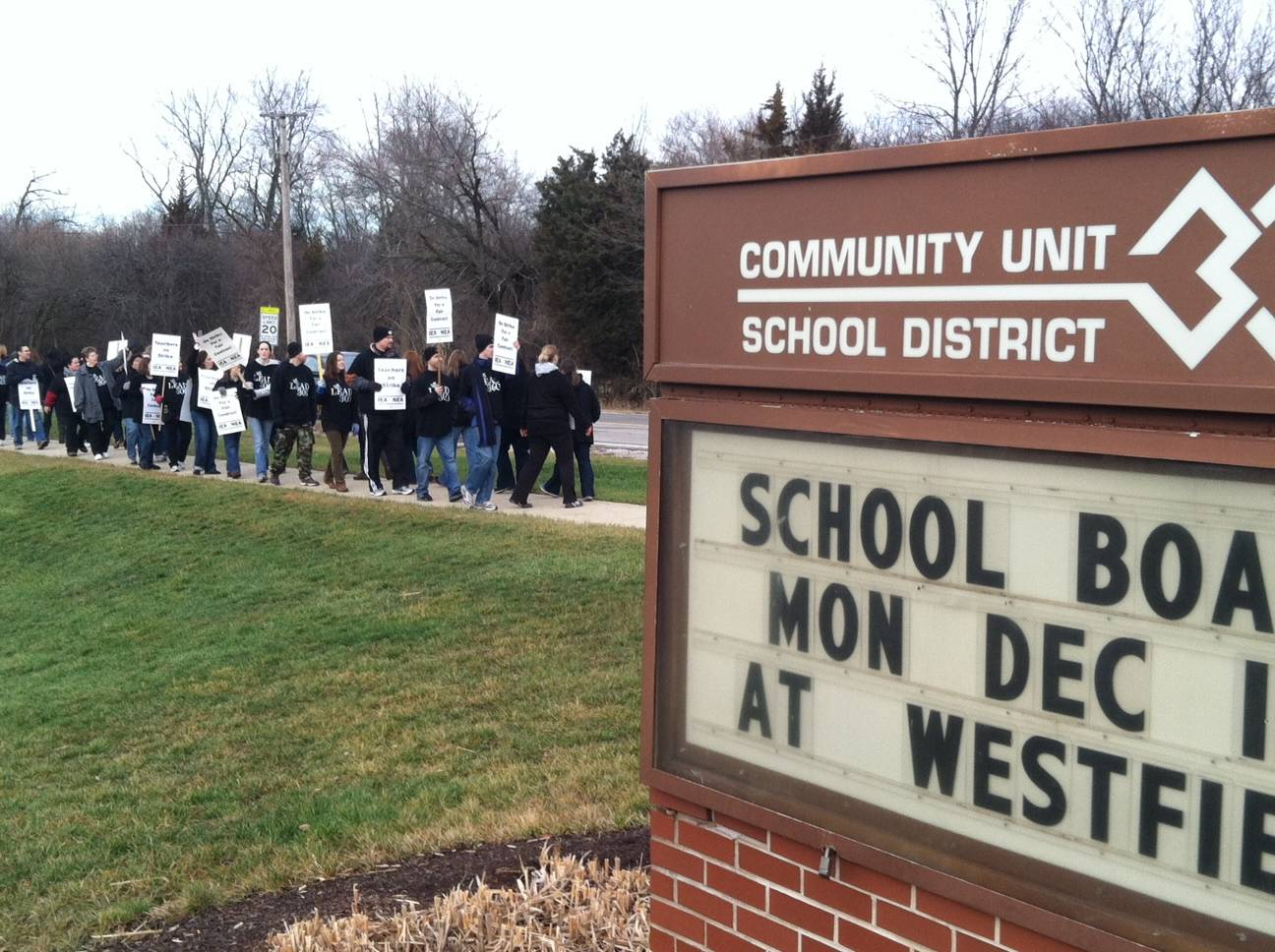 District 300 teachers walk the picket line Tuesday morning in Carpentersville outside of the school district headquarters