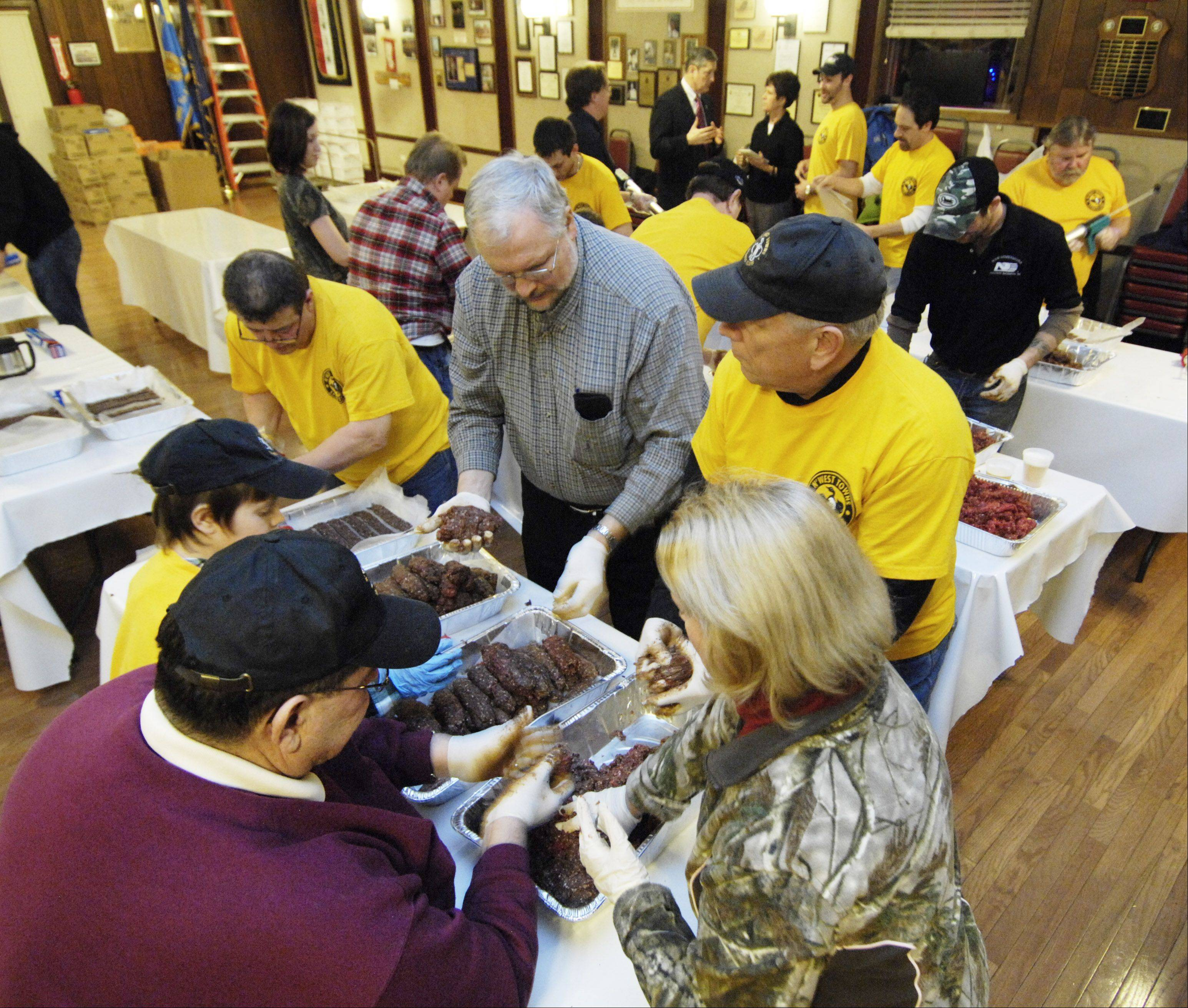 Volunteers from the Northwest Towns Sportsmen's Club met in Arlington Heights earlier this year to prepare jerky made from fresh venison for troops stationed in Afghanistan. One soldier on the receiving end, Army Capt. Court Harris of Arlington Heights, met with members late last month to thank them for their efforts.