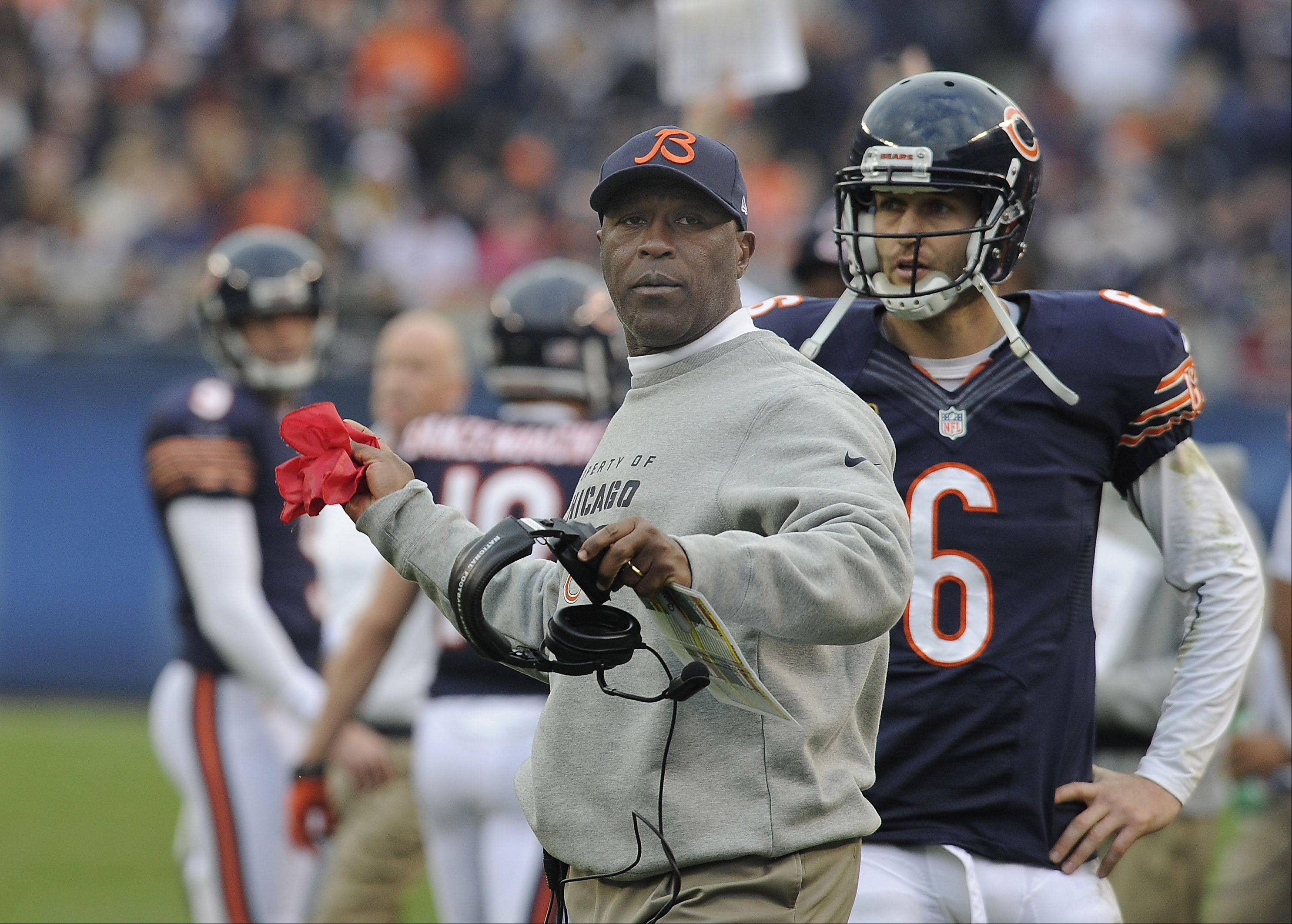 Bears coach Lovie Smith prepares to throw the challenge flag concerning a Seahawks touchdown in the fourth in the Bears loss to the Seahawks at Soldier Field in Chicago.
