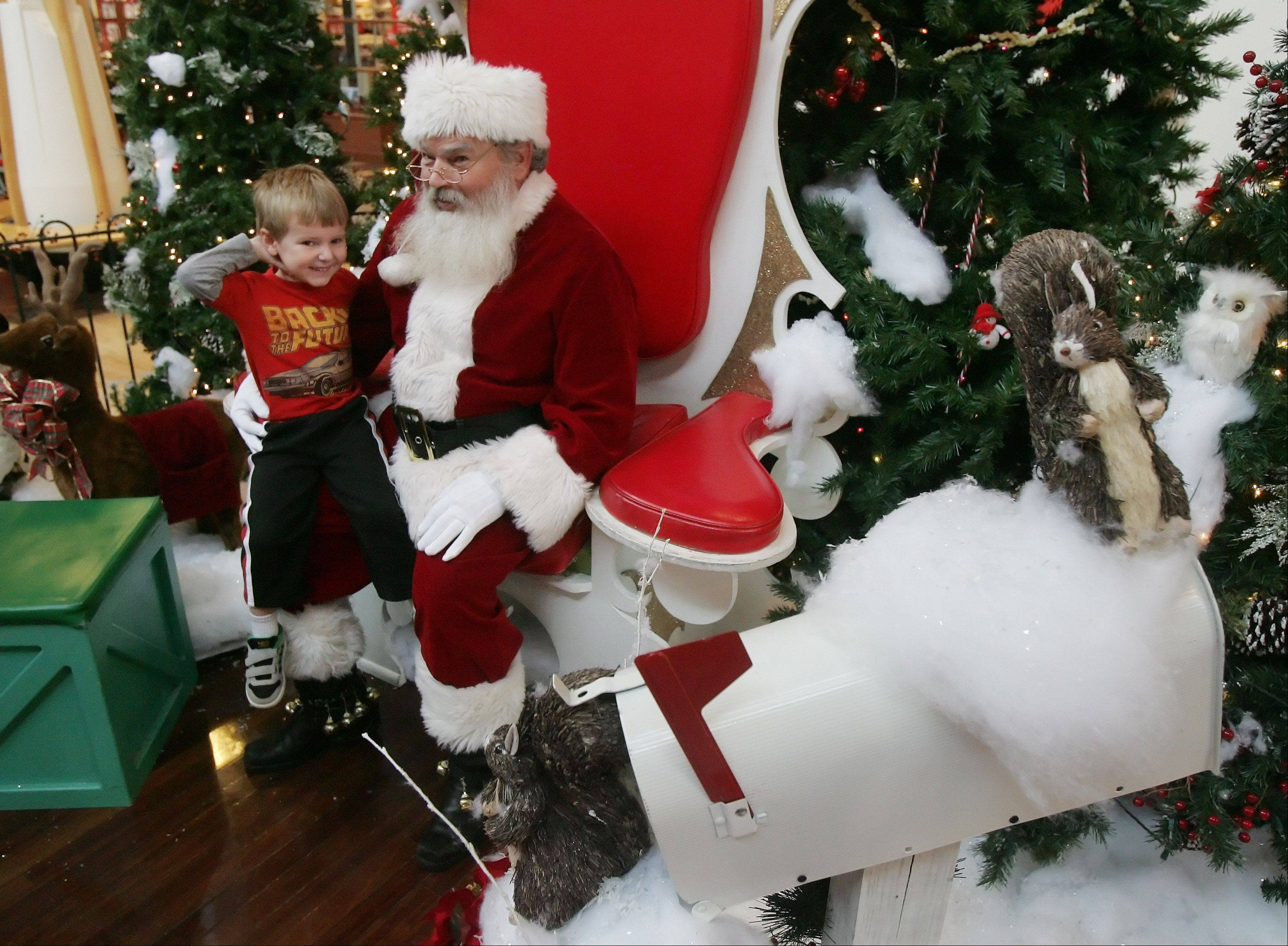 Three-year-old Nathan Likosar, of Green Oaks, tells Santa Claus what he wanted for Christmas after Santa arrived at Gurnee Mills Thursday. Kids can visit Santa Monday through Saturday from 10 a.m. to 9 p.m. and Sundays from 11 a.m. to 7 p.m.
