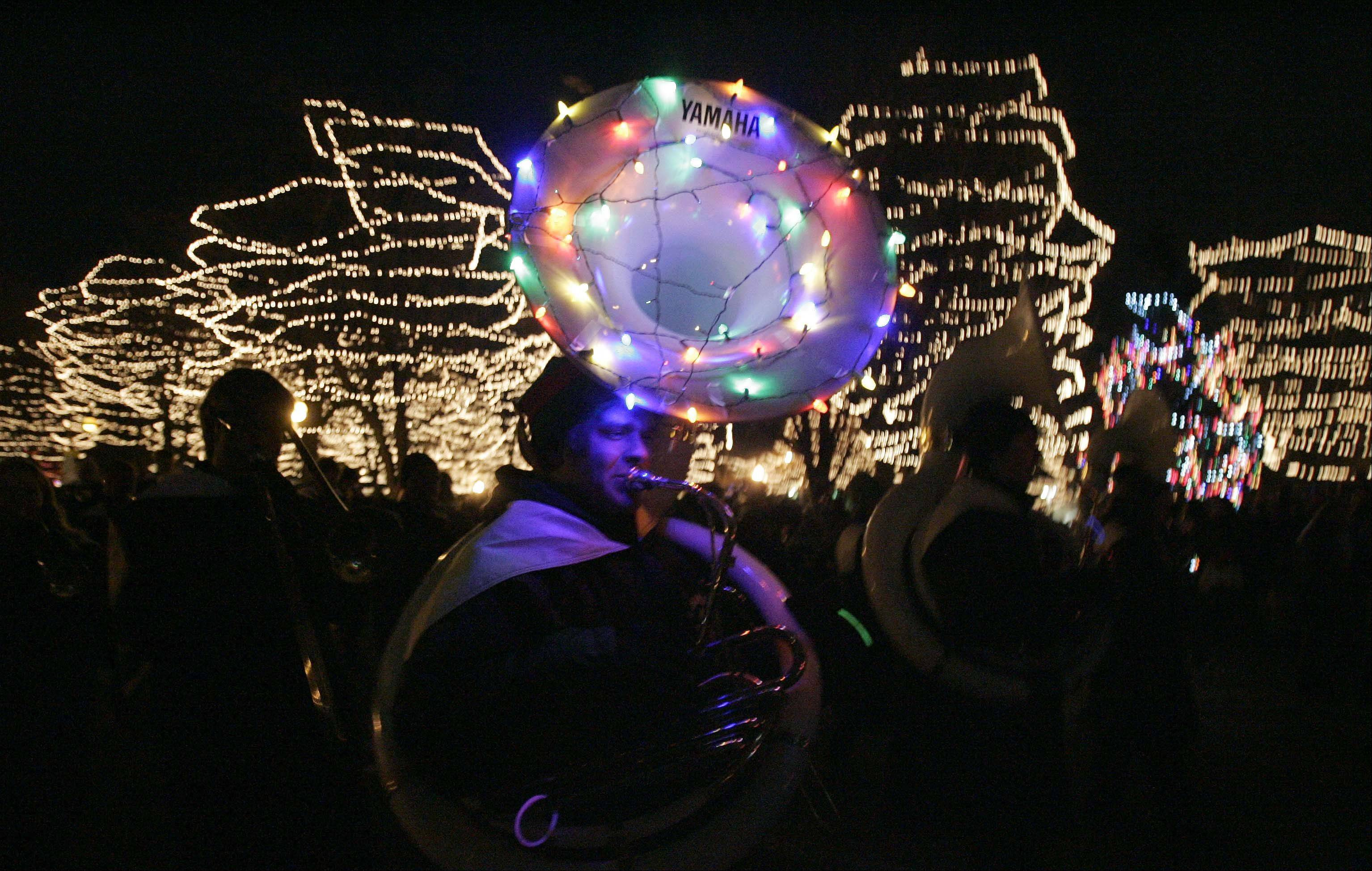 Jack Lindberg of the St. Charles East High School marching band makes his way past Lincoln Park during the Holiday Homecoming and Electric Christmas Parade on Main Street in St. Charles November 24, 2012.