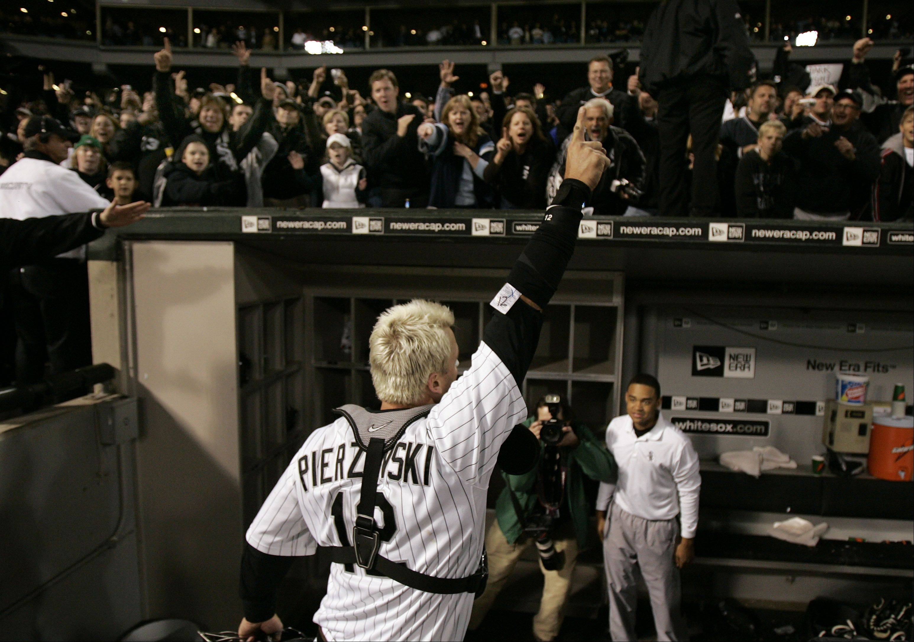 Fans cheer as A.J. Pierzynski leaves the field.