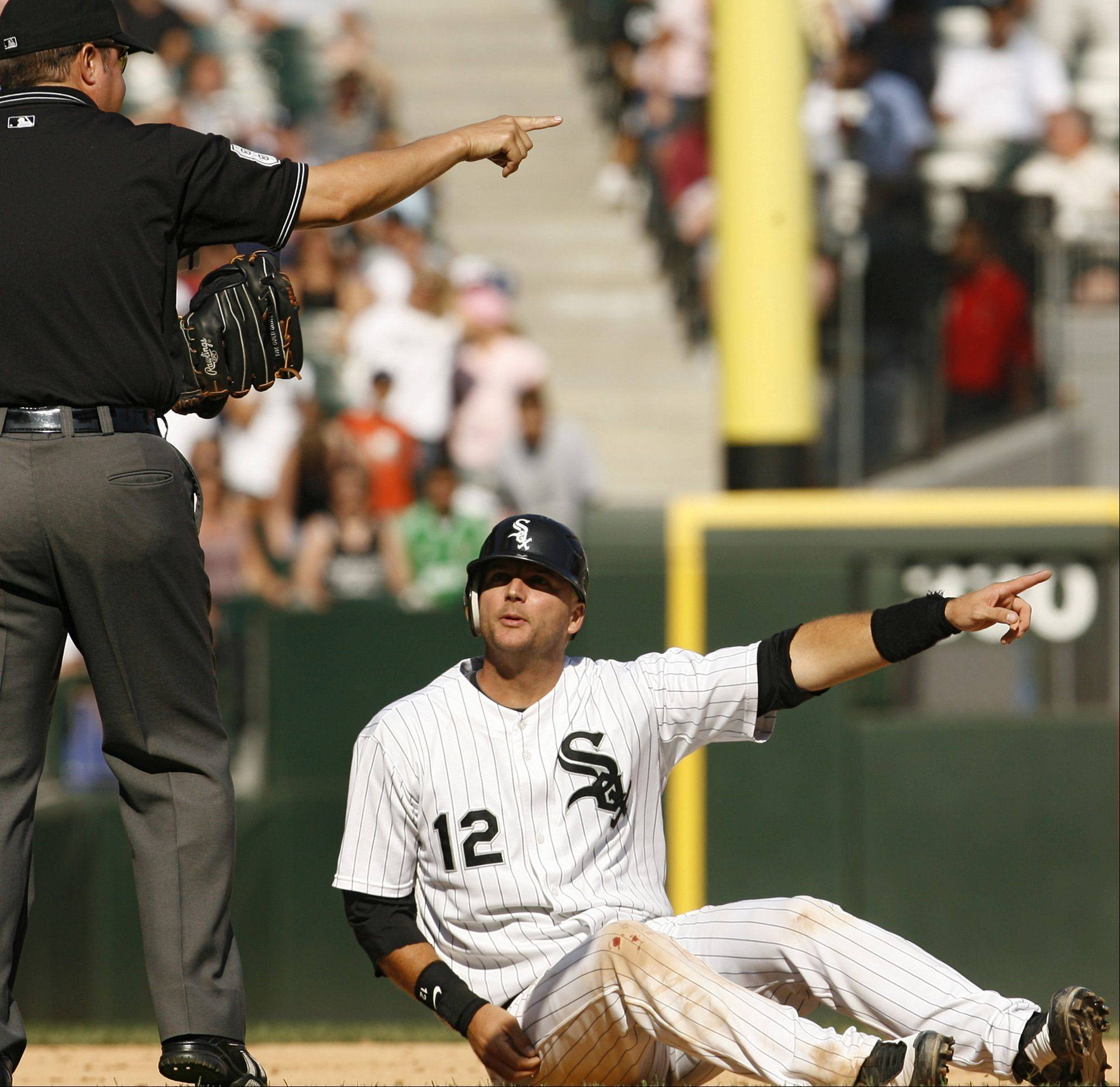 White Sox catcher A.J. Pierzynski, right, talks to second base umpire Doug Eddings about interference by Tampa Bay Rays third baseman Willy Aybar during the 10th inning of a baseball game Sunday, Aug. 24, 2008, in Chicago.