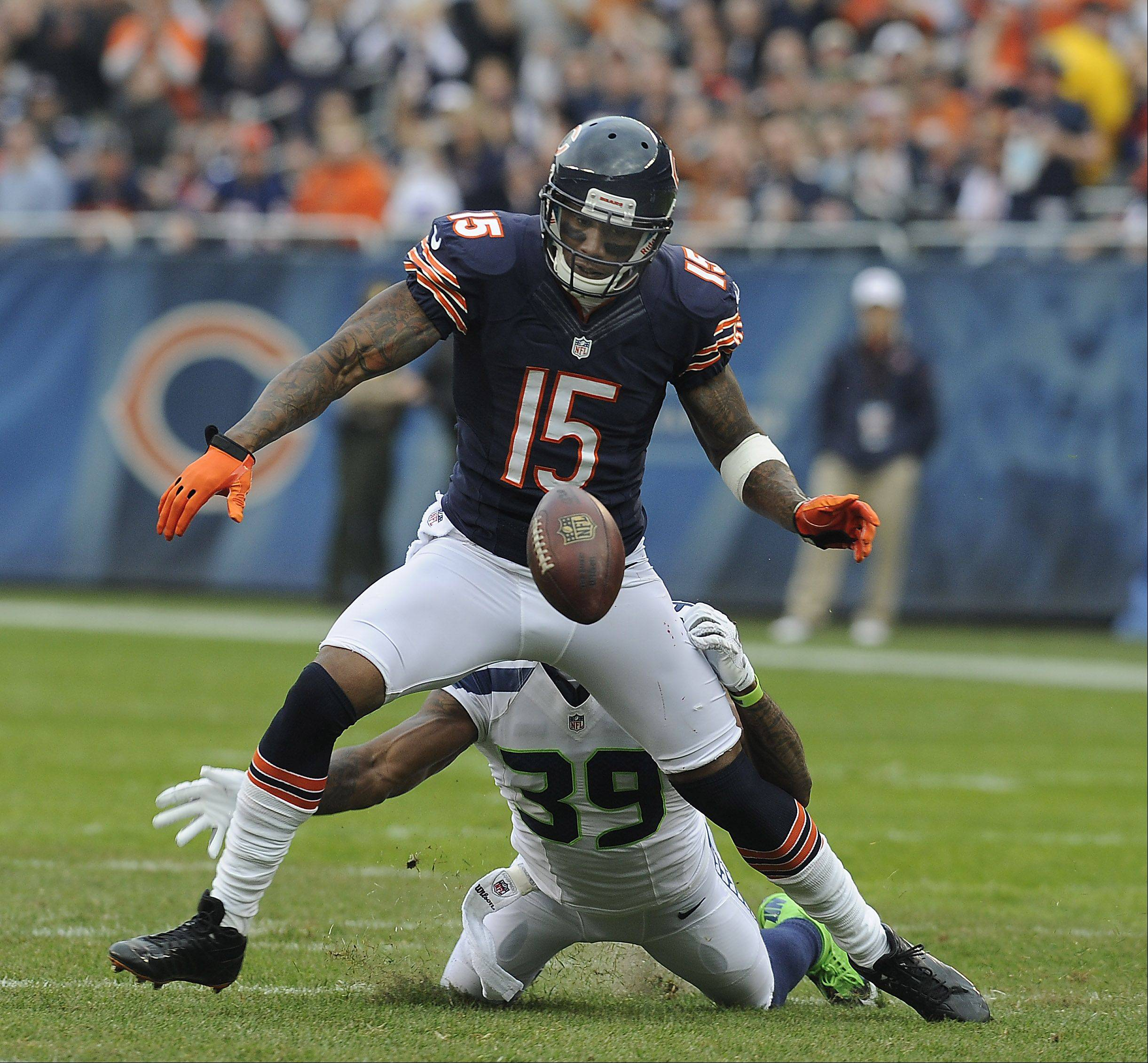 Brandon Marshall fumbles but was able to recover for a 34-yard gain in the first quarter Sunday at Soldier Field. Marshall finished with 10 catches for 165 yards.