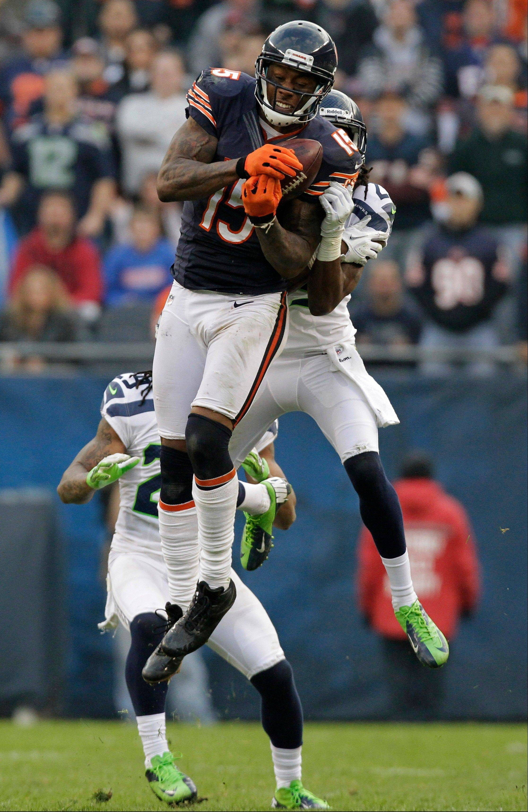 Brandon Marshall makes a catch against Seattle Seahawks cornerback Richard Sherman (25) in the second half of an NFL football game in Chicago, Sunday, Dec. 2, 2012. The catch was a key play in setting up a game-tying field goal to send the game into overtime.