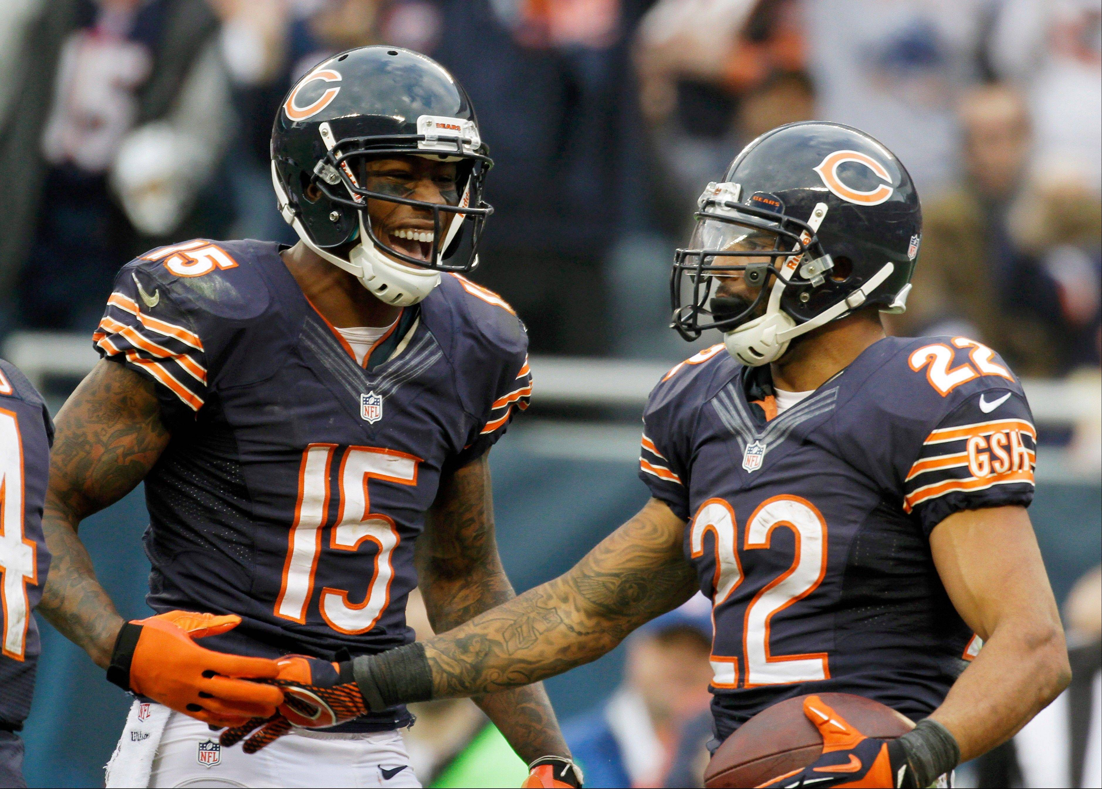 Matt Forte (22) celebrates his touchdown reception with teammate Brandon Marshall (15) in the second half of an NFL football game against the Seattle Seahawks in Chicago, Sunday, Dec. 2, 2012.