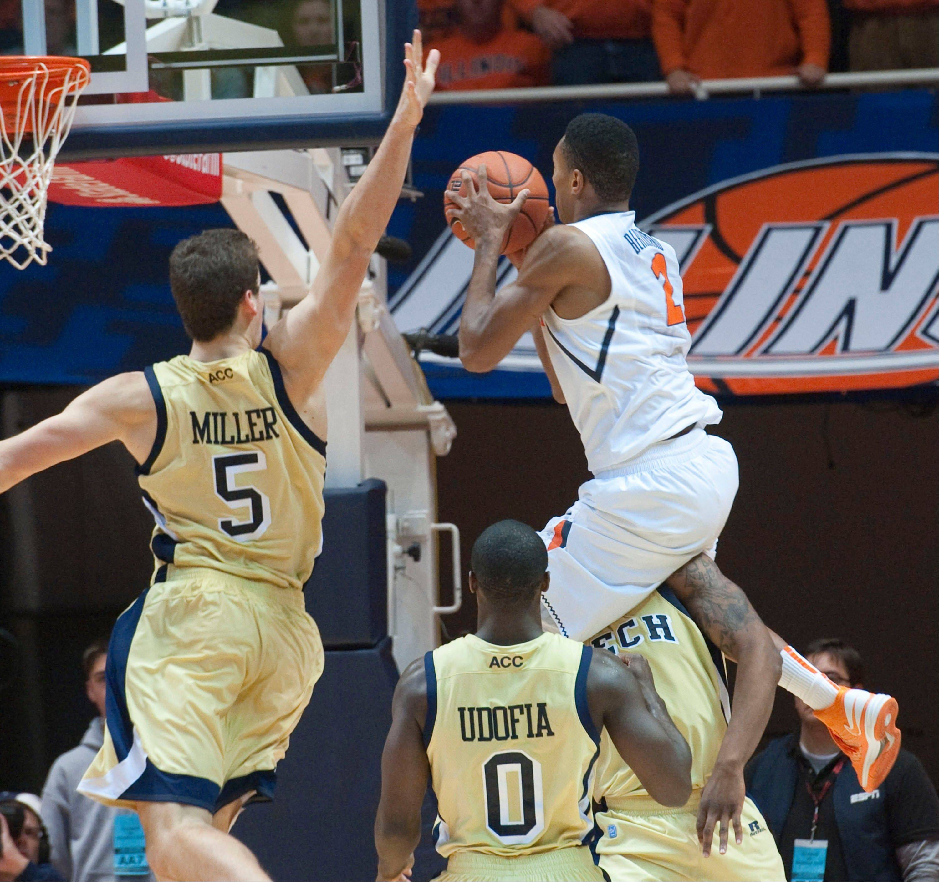 Illinois' Joseph Bertrand (2) collides with Georgia Tech Marcus Georges-Hunt (3) as Georgia Tech Daniel Miller (5) tries to block the shot Wednesday during the second half in Champaign.