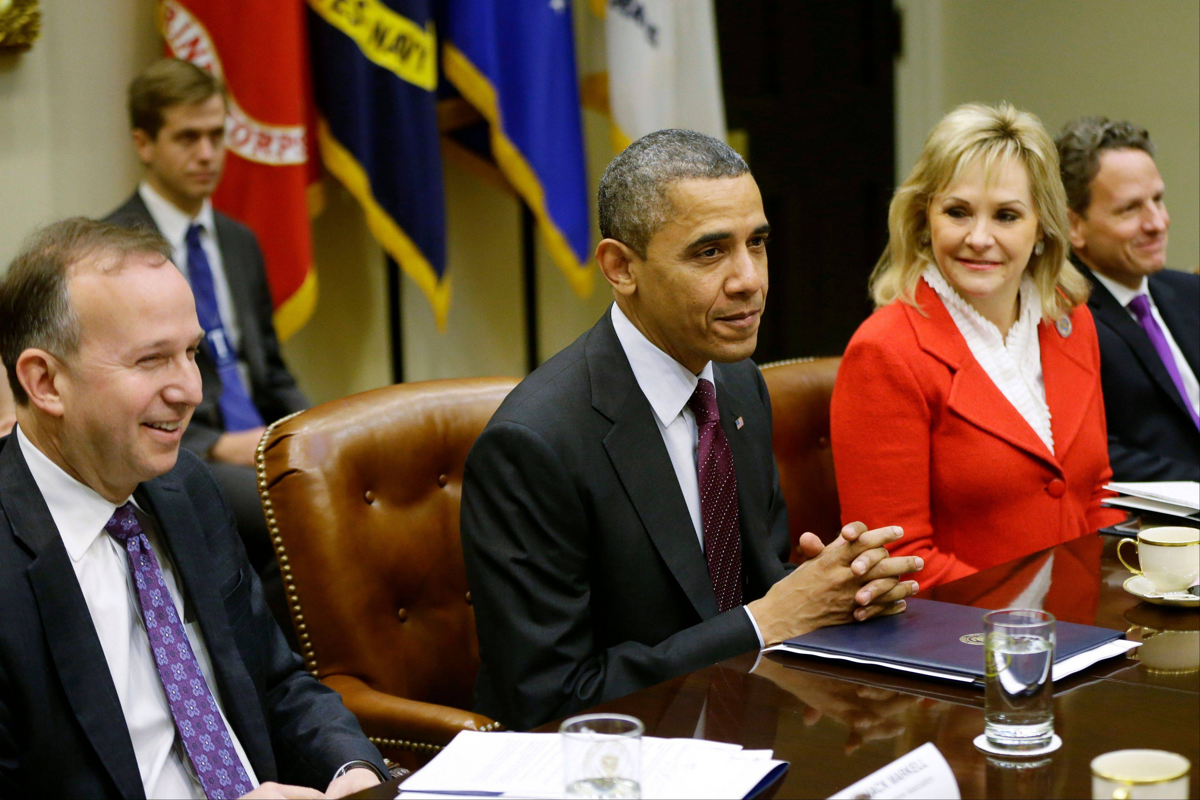 President Barack Obama, flanked by National Governors Association (NGA) Chairman, Delaware Gov. Jack Martell, and NGA Vice Chair, Oklahoma Gov. Mary Fallin, meets with the NGA executive committee regarding the fiscal cliff, Tuesday, Dec. 4, 2012, in the Roosevelt Room at the White House in Washington. Treasury Secretary Tim Geithner is at right.