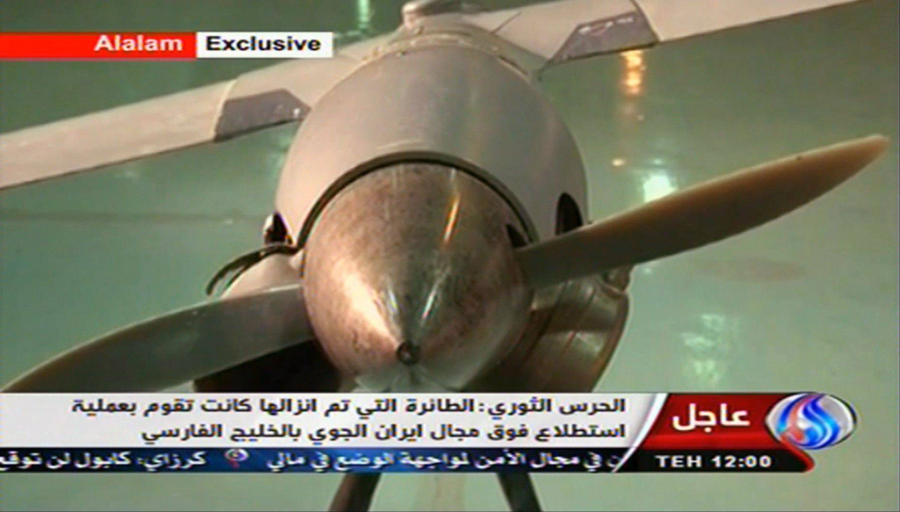 This image taken from the Iranian state TV�s Arabic-language channel Al-Alam shows what they purport to be an intact ScanEagle drone aircraft put on display Tuesday. Iran claimed Tuesday it had captured a U.S. drone after it entered Iranian airspace over the Persian Gulf.
