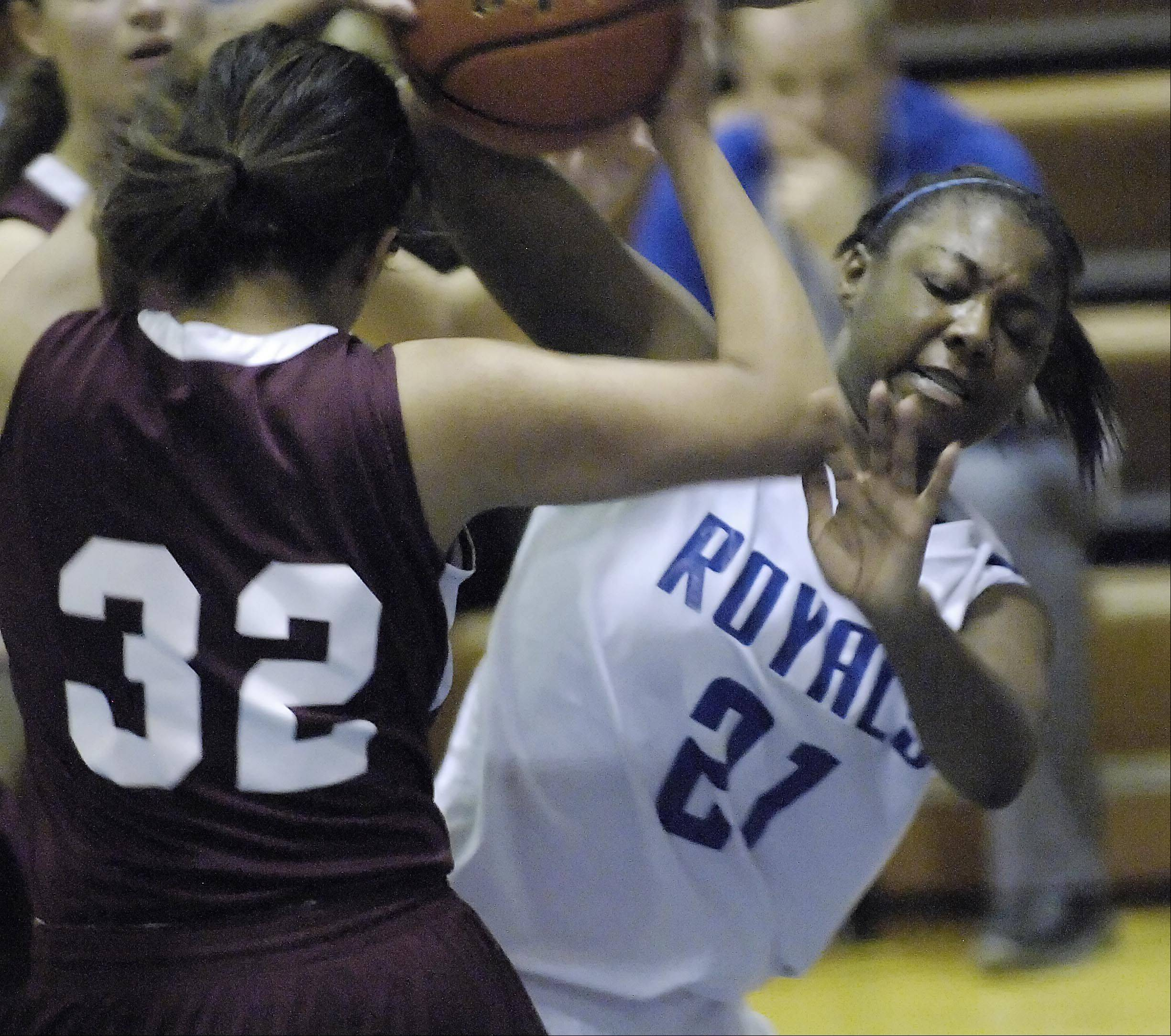 Larkin�s Shawndrea Hill and Elgin�s Jess Ramirez fight for the ball.