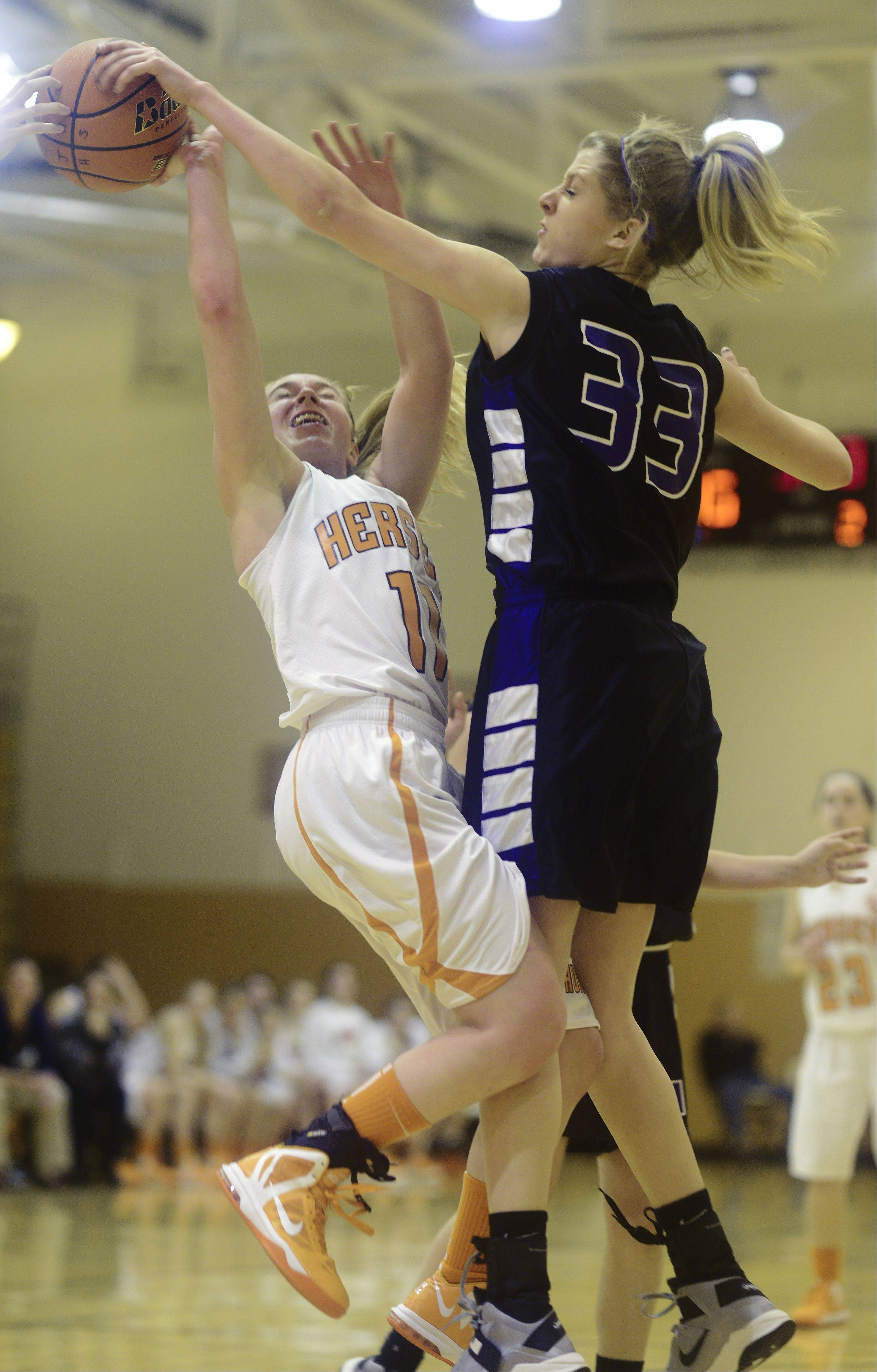 Hersey�s Morgan Harris, left, has her shot blocked by Rolling Meadows� Jenny Vliet during Tuesday�s game.