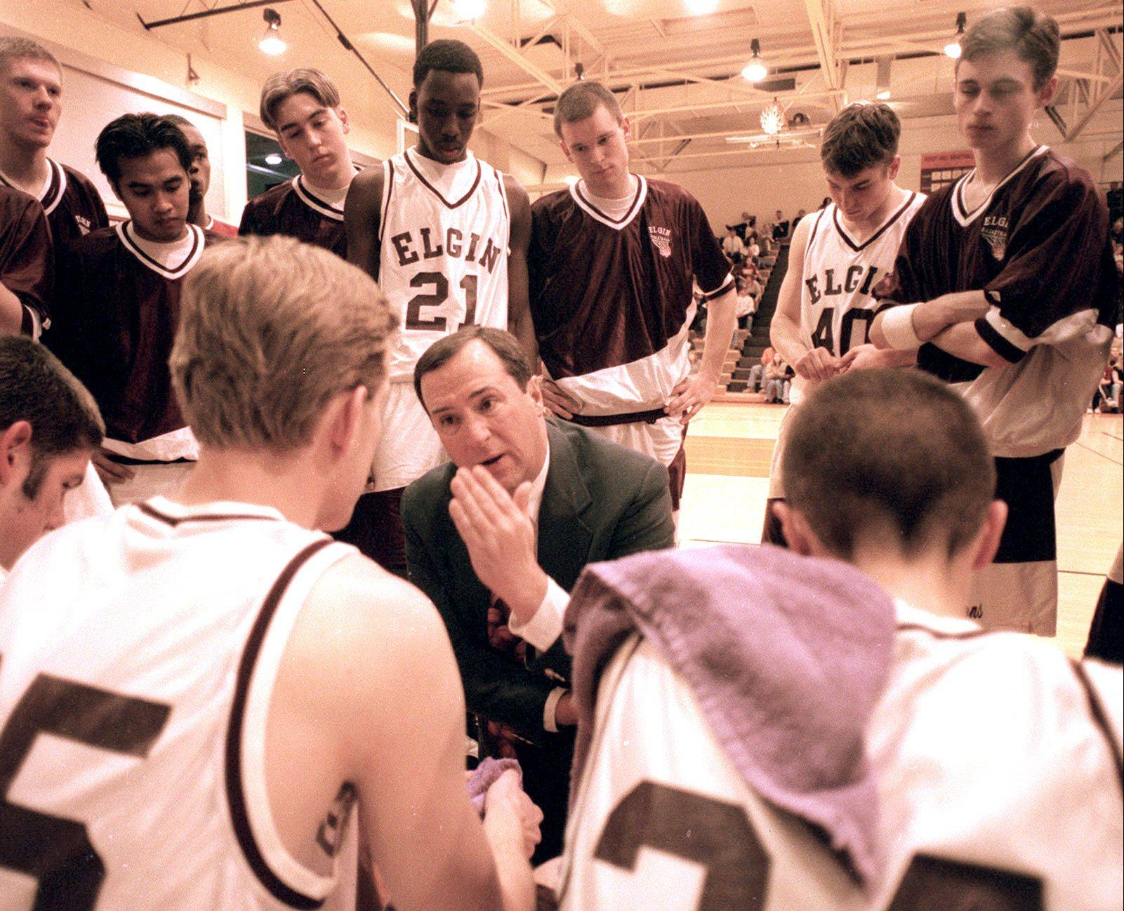 Former Elgin High boys basketball coach Jim Harrington, above speaking to his 1997-98 Elite Eight team during a timeout, is the IBCA�s 2012 Buzzy O�Connor award recipient, recognizing his lifetime contributions to the game of basketball.