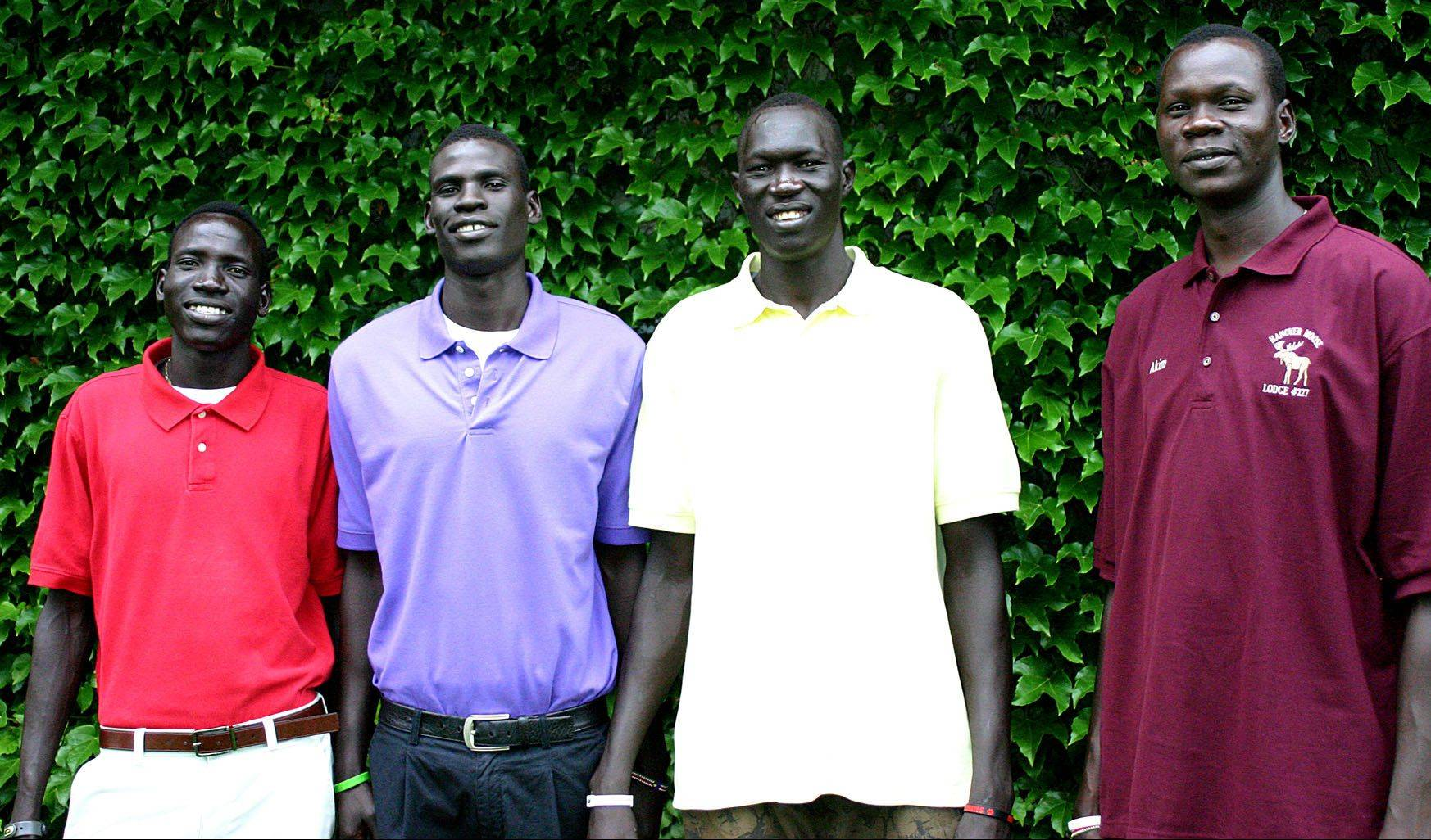 Wal Khat, from left, Mangisto Deng, Makur Puou and Akim Nyang are four Sudanese athletes at Mooseheart Child City and School. The latter three have been cleared to play basketball again after a judge granted a temporary restraining order. The IHSA had previously declared them ineligible.