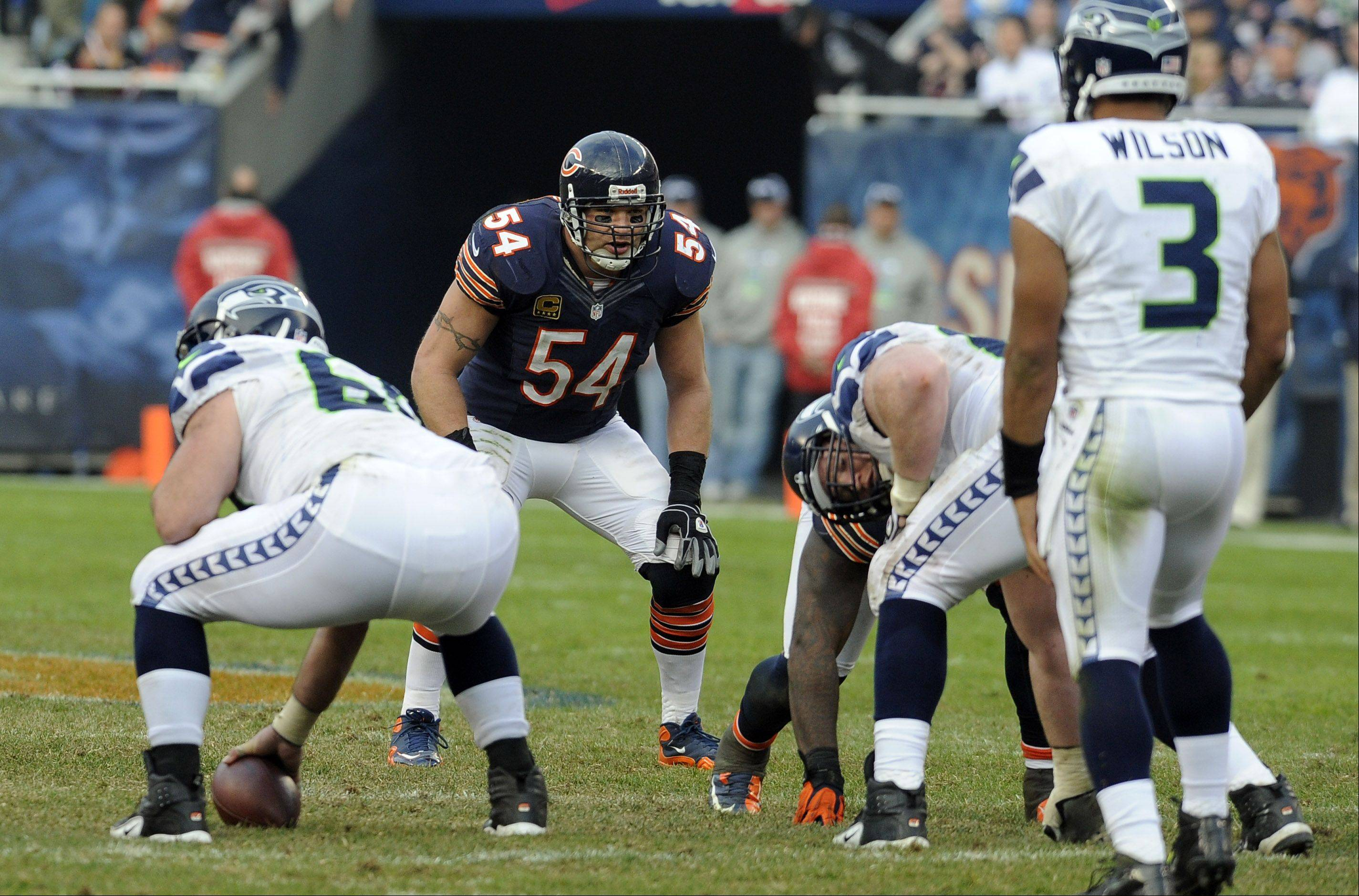 Mark Welsh/mwelsh@dailyherald.com Bears Brian Urlacher on defense suffered an injury that will sideline him for the rest of the season in the Bears loss to the Seahawks at Soldier Field in Chicago.