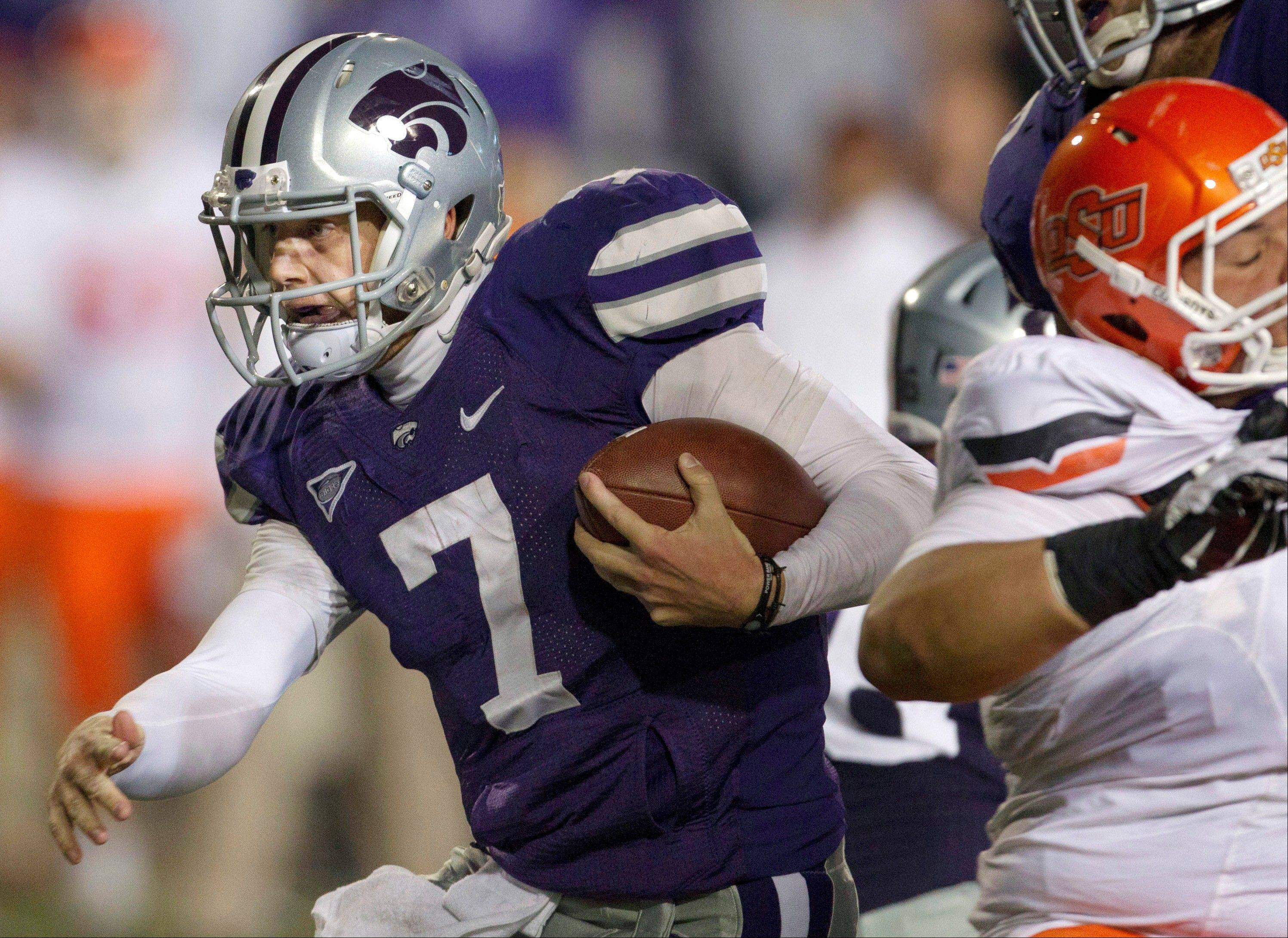 Kansas State quarterback Collin Klein runs for a first down against Oklahoma State. Once the front-runner for the award, Klein will face stiff competition from Texas A&M quarterback Johnny Manziel and Notre Dame linebacker Manti Te�o when the Heisman is given out Saturday night in New York City.