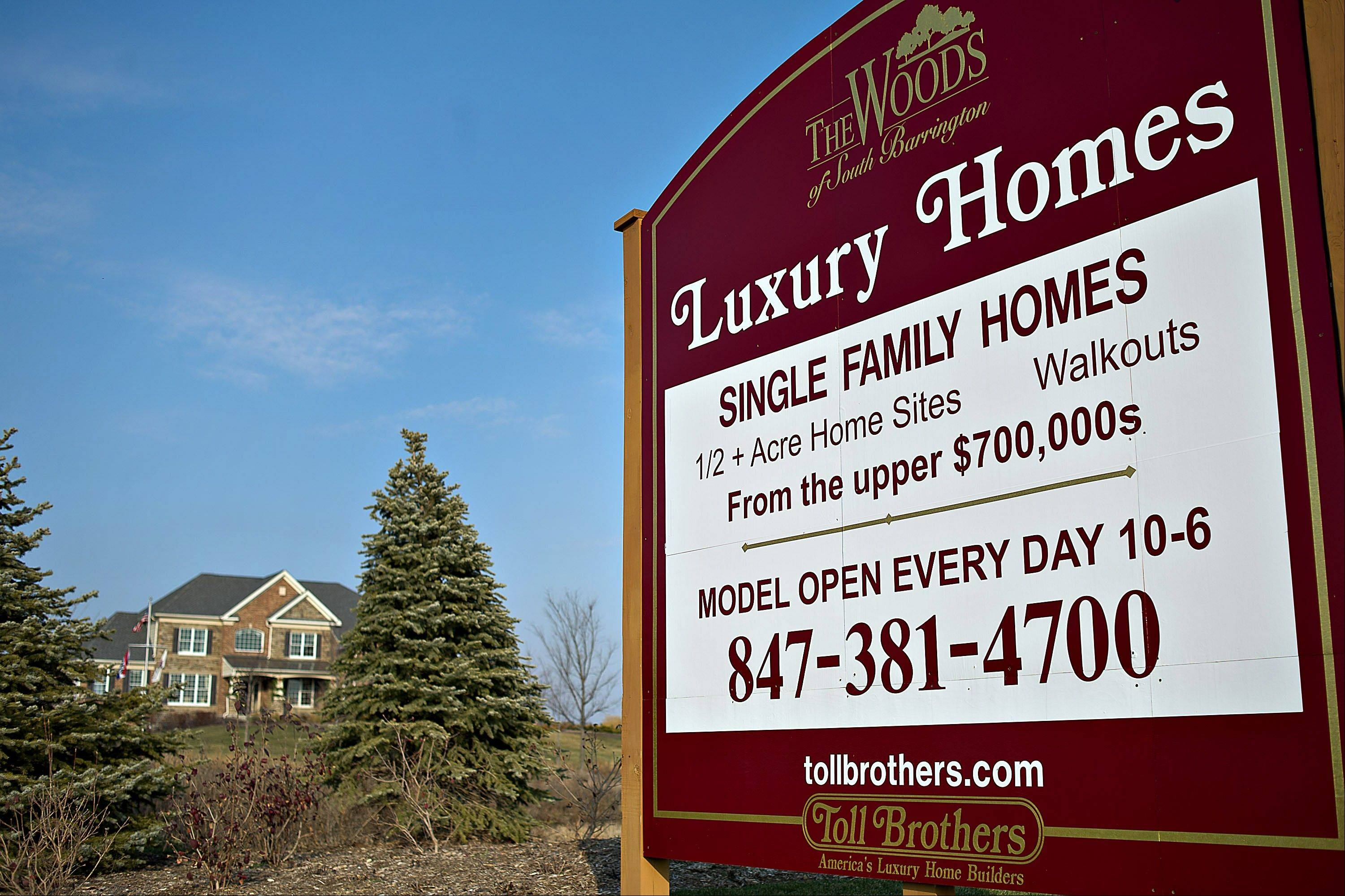 Luxury homebuilder Toll Brothers Inc., developer of The Woods of South Barrington, says its fiscal fourth-quarter net income soared, helped by a large income tax benefit and a 48 percent rise in revenue. The luxury homebuilder delivered more homes and its order backlog increased.