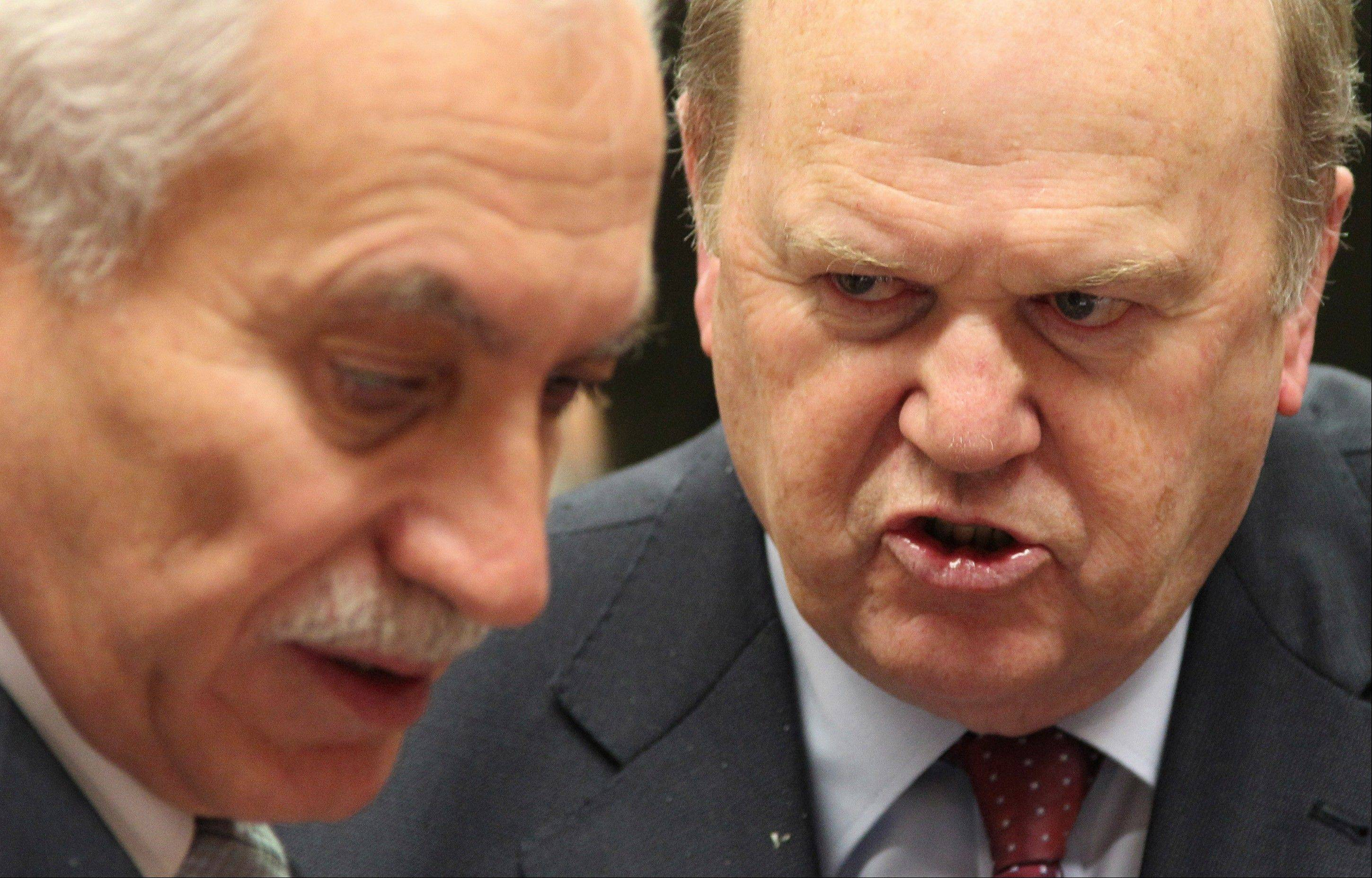 Irish Finance Minister Michael Noonan, right, talks with Cypriot Finance Minister and President of the EU rotating Council Vassos Chiarly Tuesday during the EU finance ministers meeting at the European Council building in Brussels.