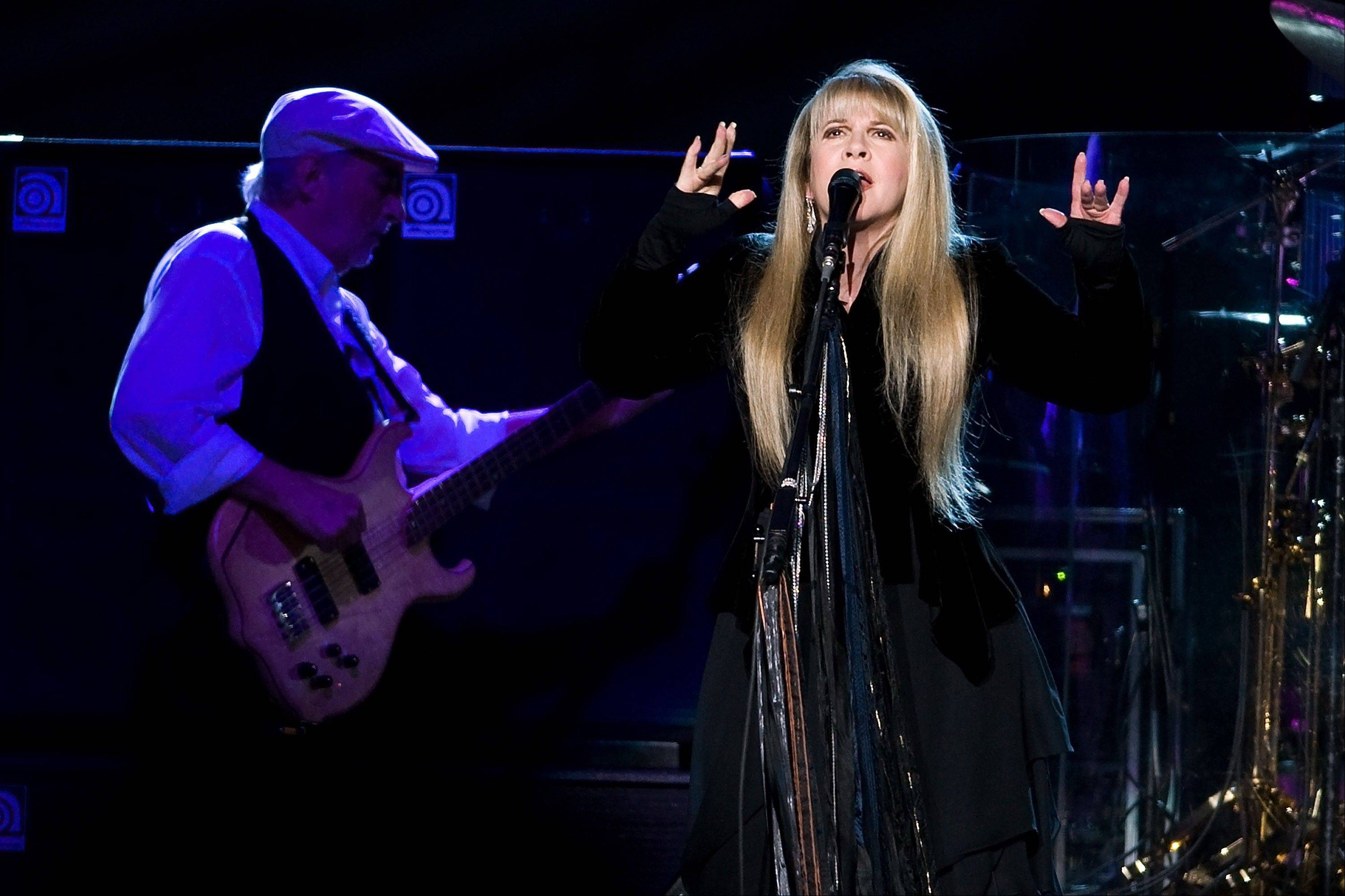 Fleetwood Mac, including John McVie, left, and Stevie Nicks, is heading back on the road with a 34-city U.S. tour kicking off April 3 in Columbus, Ohio.
