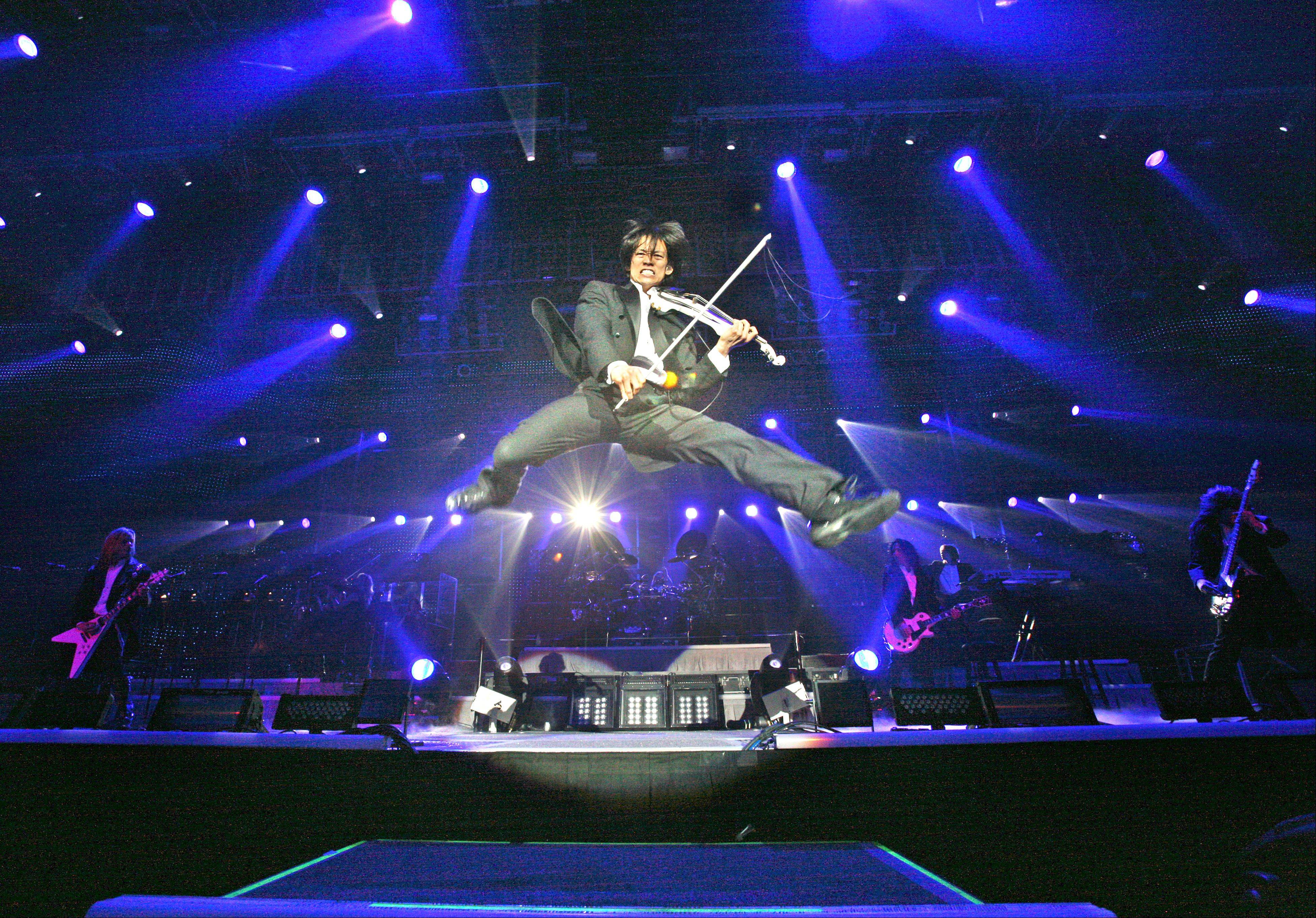 Roddy Chong, of Schaumburg, leaps into the air while playing rock violin with the Trans-Siberian Orchestra. The TSO will do two shows this Saturday at the Allstate Arena.